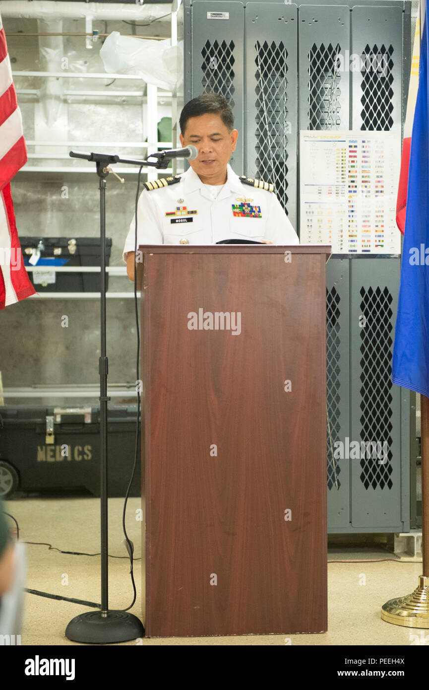 150814-N-MK341-033 SAN FERNANDO CITY, Philippines (August 14, 2015) - Commander, Naval Task Force 11 Capt. Albert Mogol delivers a speech during a closing reception aboard the Military Sealift Command joint high speed vessel USNS Millinocket (JHSV 3) Aug. 14. Millinocket and embarked Task Force Forager are serving as the secondary platform for Pacific Partnership, led by an expeditionary command element from the Navy's 30th Naval Construction Regiment (30 NCR) from Port Hueneme, Calif. Now in its 10th iteration, Pacific Partnership is the largest annual multilateral humanitarian assistance and - Stock Image