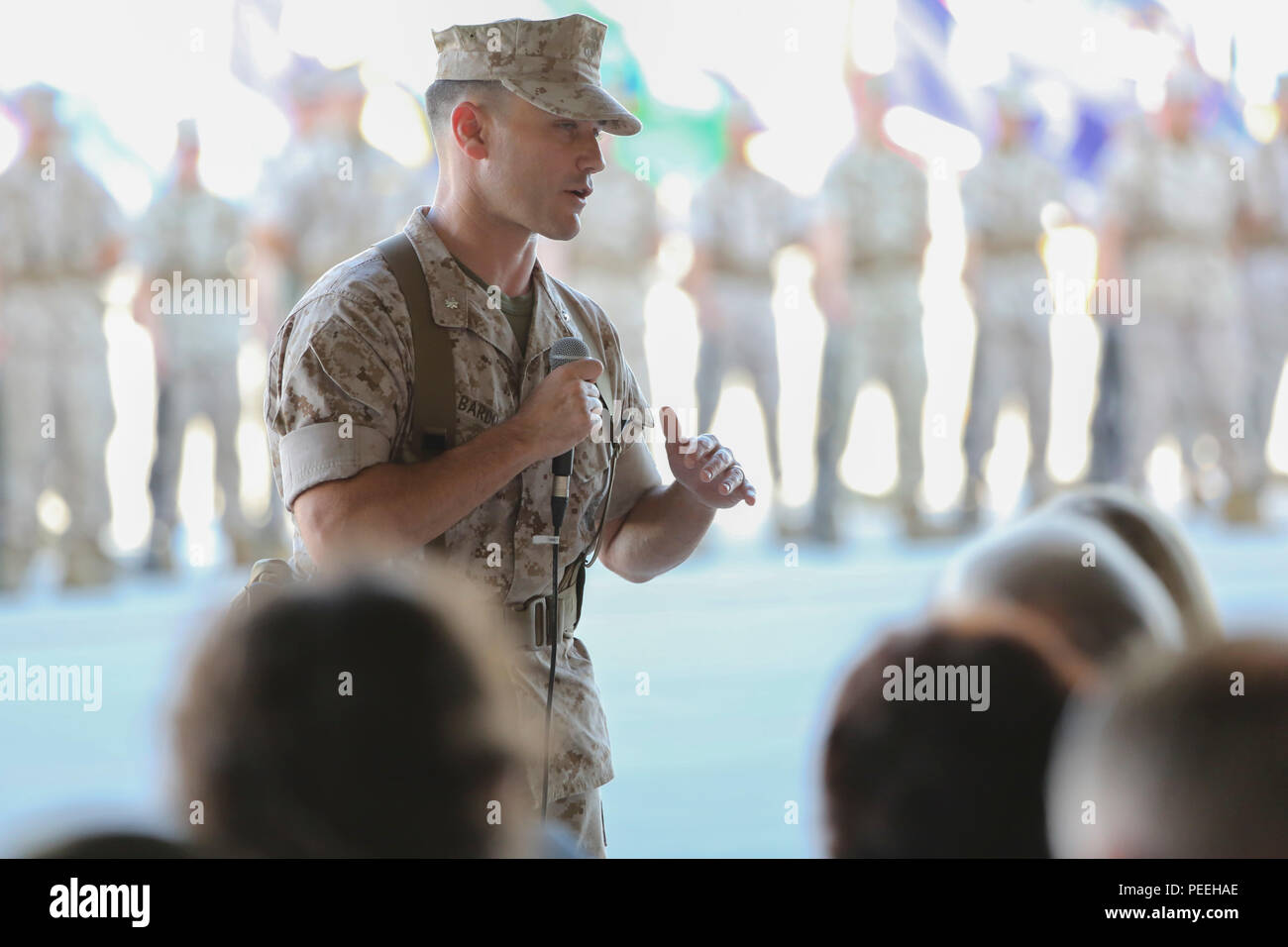 "Incoming Marine Fighter Attack Squadron 121 commanding officer, Lt. Col. James Bardo, briefly addresses attendees of the squadron's change of command ceremony aboard Marine Corps Air Station Yuma, Arizona, Friday, August 14, 2015.  ""I am excited for the opportunity to command these Marines and to command the first operational F-35 squadron,"" said Bardo. Stock Photo"