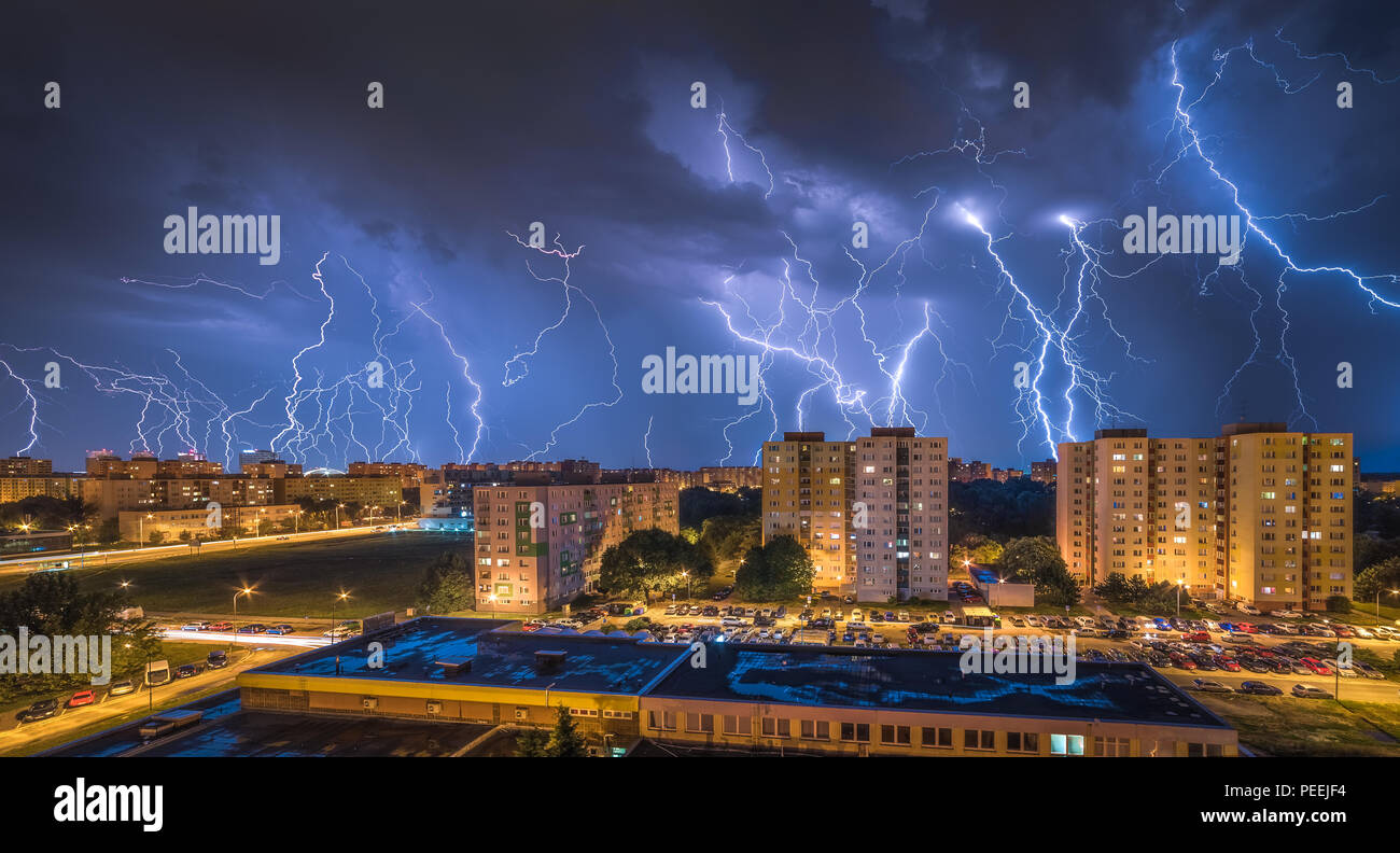 Many Lightnings Over Housing Estate. Night Storm in the City. Stock Photo