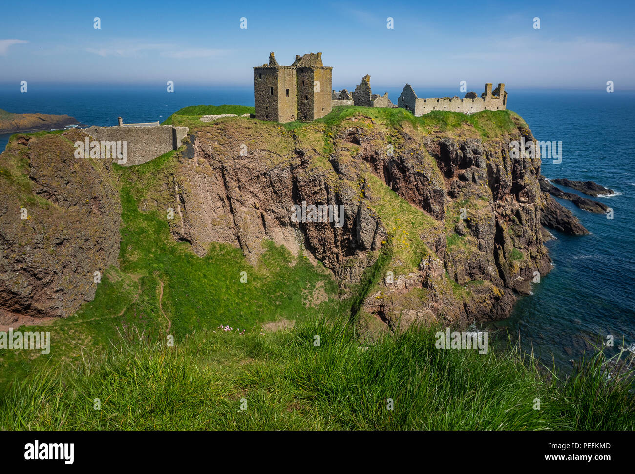 The reamins of the medieval fortress, Dunnottar Castle, located upon a rocky headland on the north-east coast of Scotland, - Stock Image