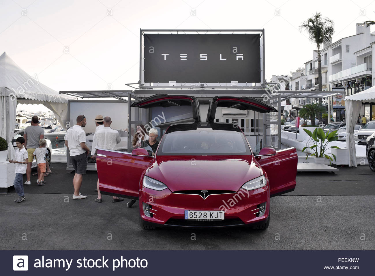 Tesla Model X demonstration - luxury electric car with gull-wing doors displayed in Puerto Banus marina south-west of Marbella Spain Europe. - Stock Image