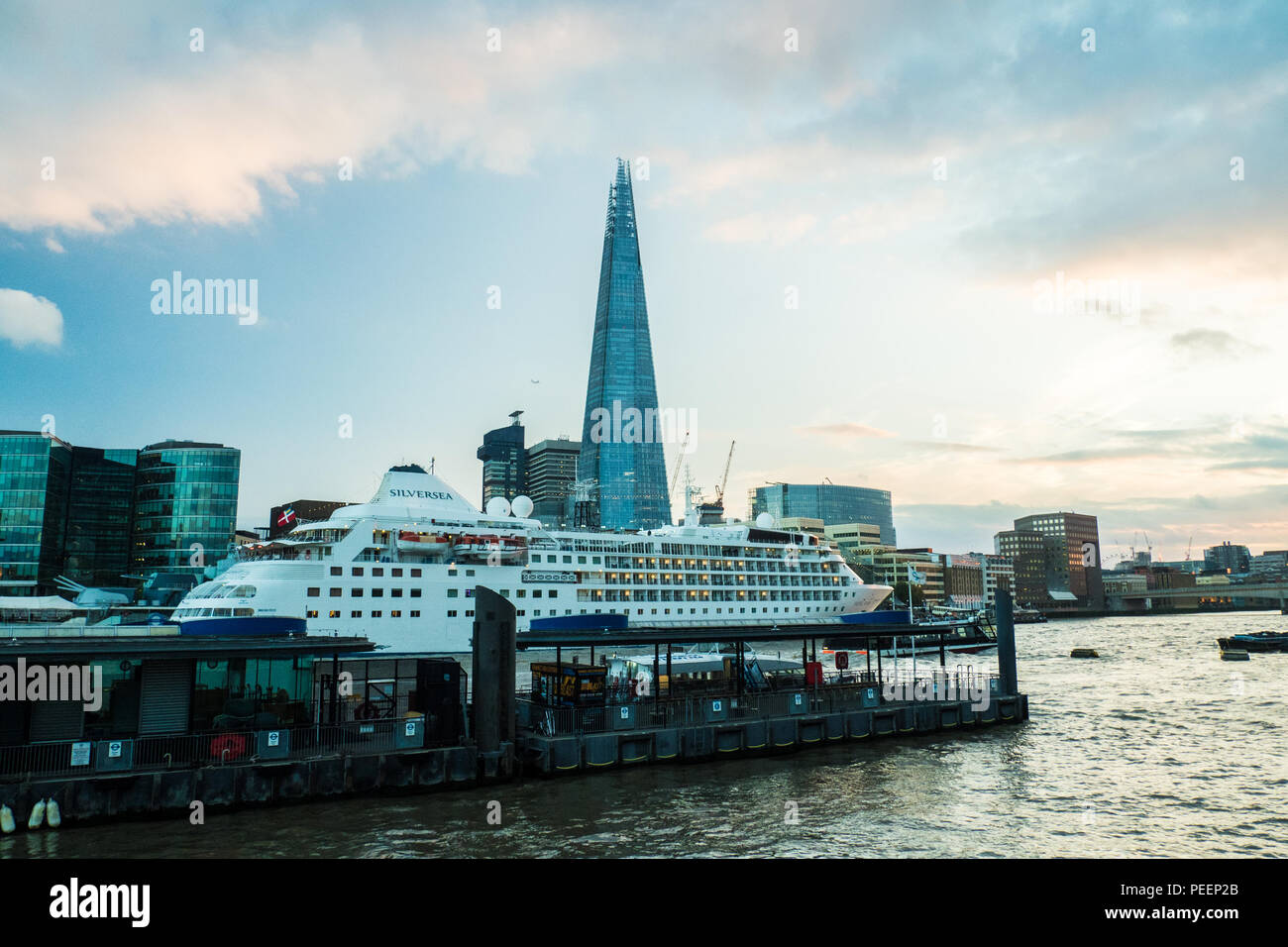 Cruise Ship on the River Thames with The Shard (of Glass) skyscraper, London. - Stock Image