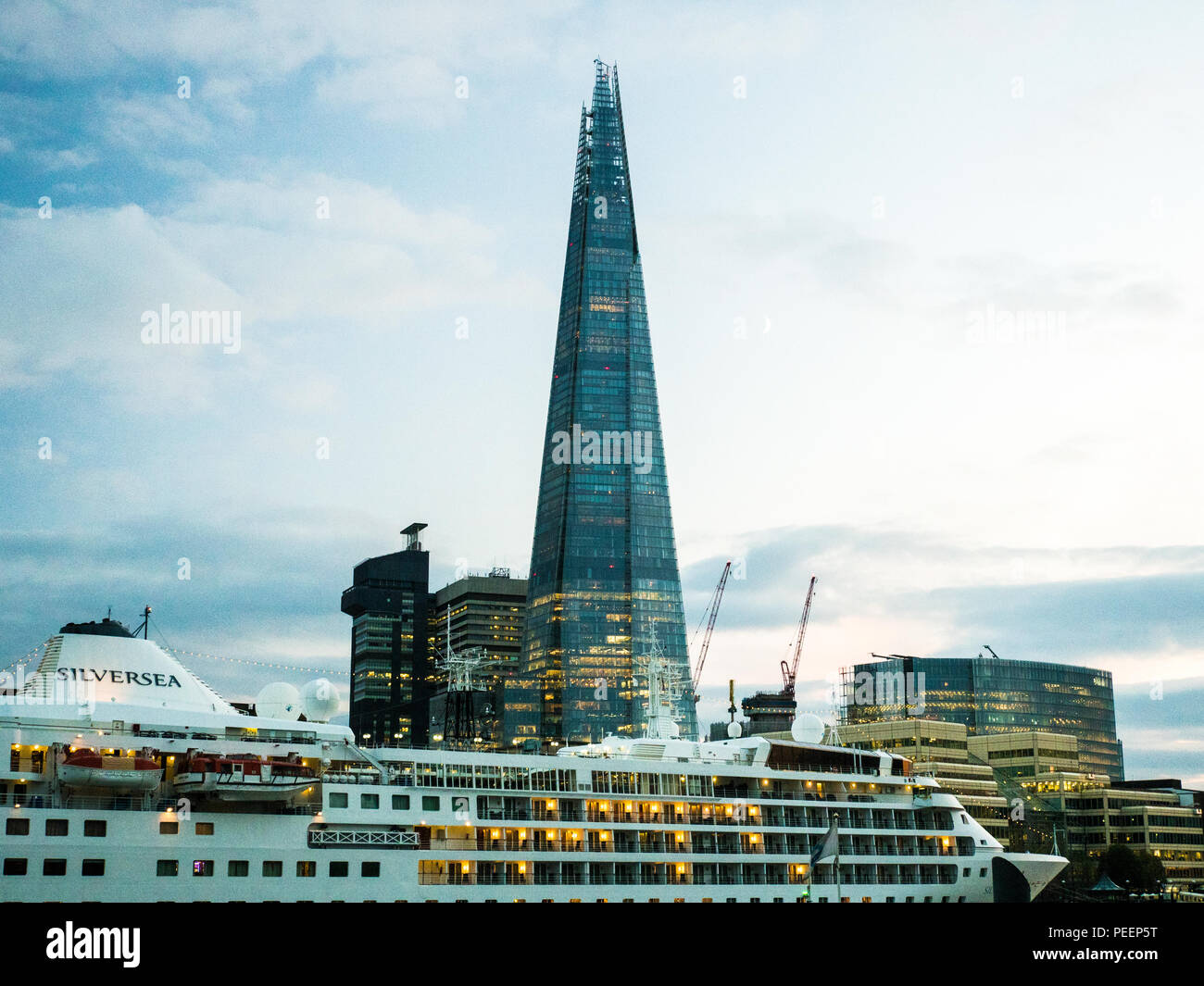 Cruise Ship on the River Thames with The Shard (of Glass) skyscraper in the background, London. - Stock Image