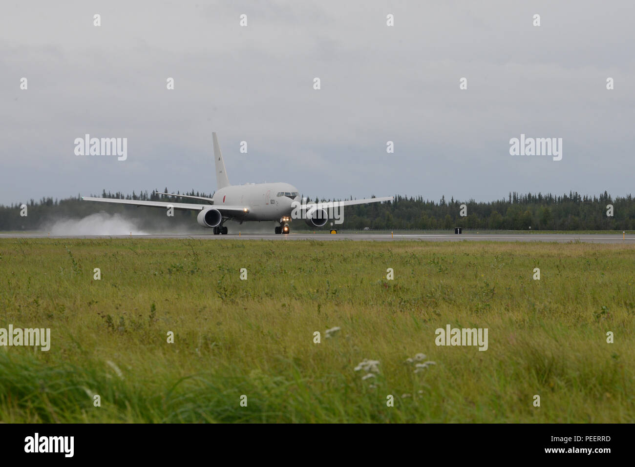 A Japanese Air Self-Defense Force KC-767 tanker takes off from Eielson Air Force Base, Alaska, Aug. 10, 2015, during Red Flag-Alaska (RF-A) 15-3. RF-A is a series of Pacific Air Forces commander-directed field training exercises for U.S. and partner nation forces, providing combined offensive counter-air, interdiction, close air support and large force employment training in a simulated combat environment. (U.S. Air Force photo by Senior Airman Ashley Nicole Taylor/Released) Stock Photo