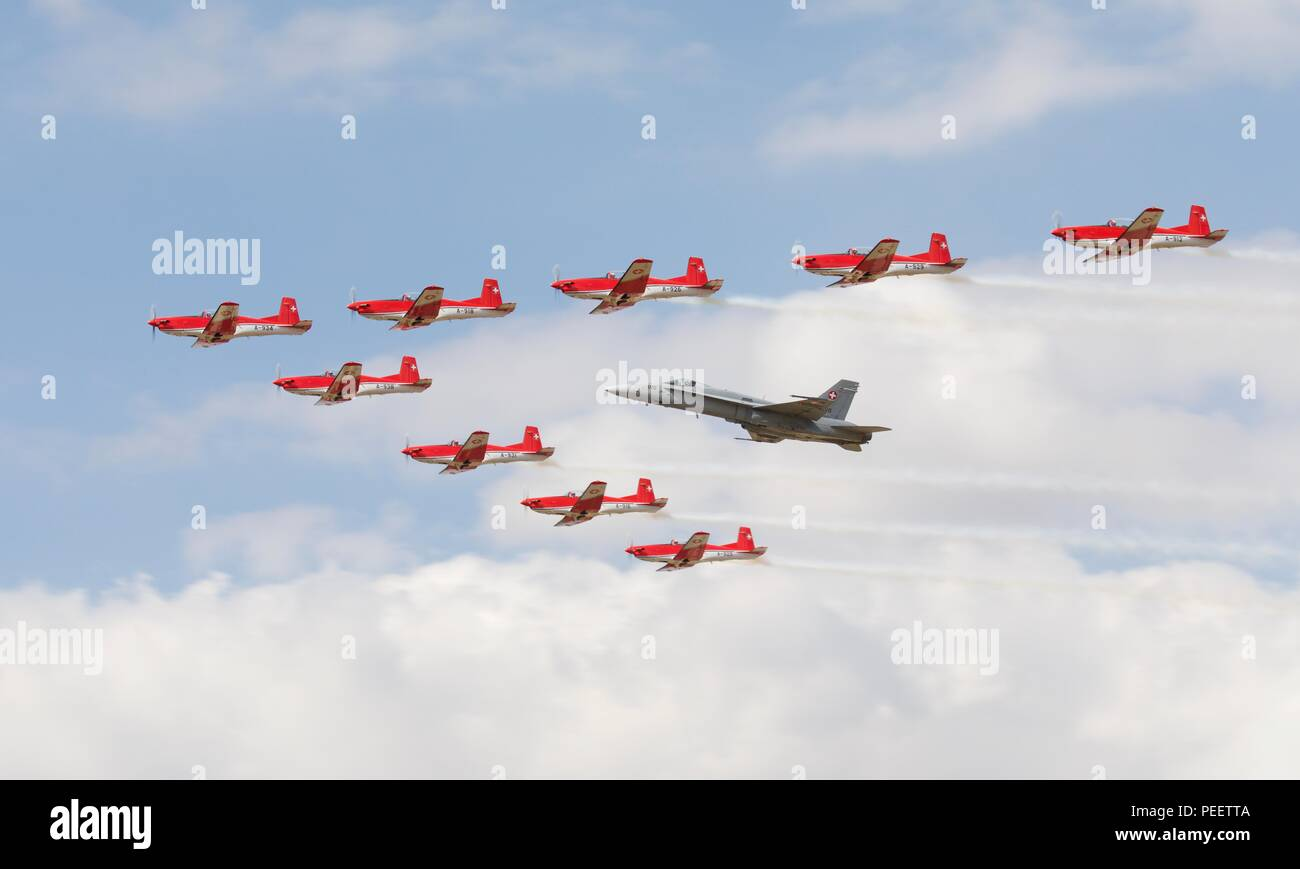 Swiss Air Force PC-7 aerobatic display team flying in formation with a Swiss F/A-18C Hornet at the 2018 Royal International Air Tattoo Stock Photo