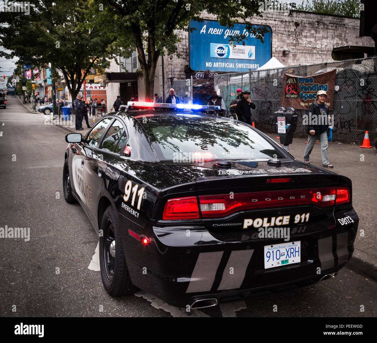 VANCOUVER, BC, CANADA - MAY 11, 2016: VPD cruiser on Vancouver's Downtown Eastside with officers in the background dealing with an issue - Stock Image