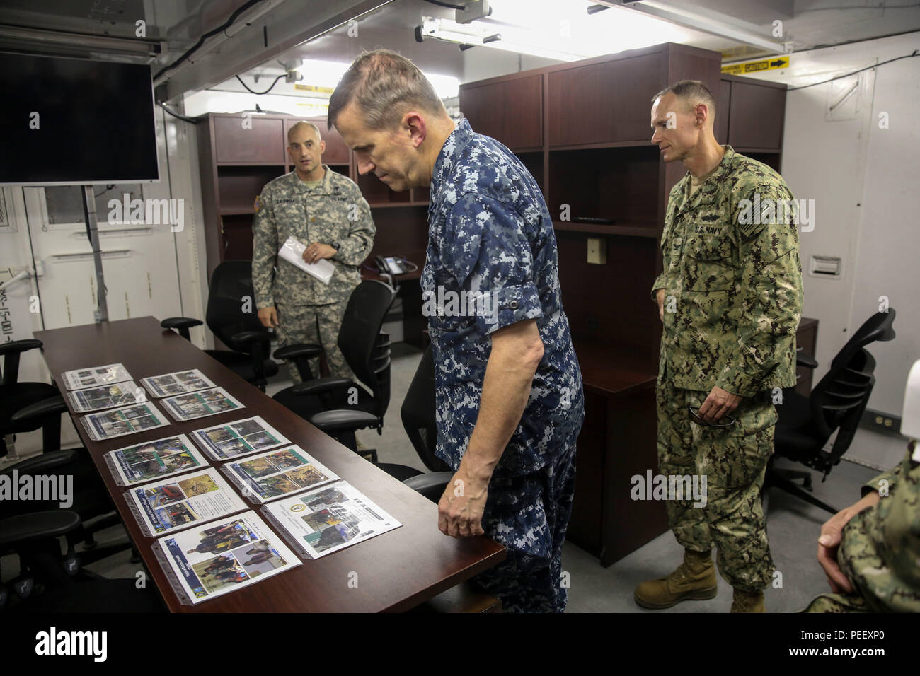 150813-M-GO800-121 SAN FERNANDO CITY, Philippines (August 13, 2015) – Commander, Task Force 73, Rear Adm. Charles Williams, examines the work done by the Task Force Forager medical team aboard the Military Sealift Command joint high speed vessel USNS Millinocket (JHSV 3) August 13. Task Force Forager will be in the Philippines until Aug. 15 providing medical and engineering assistance. Task Force Forager, embarked aboard the Military Sealift Command joint high speed vessel USNS Millinocket (JHSV 3) is serving as the secondary platform for Pacific Partnership, led by an expeditionary command el - Stock Image