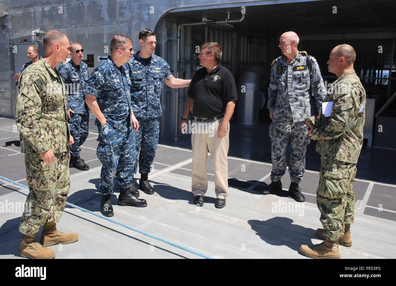 150813-M-GO800-099 SAN FERNANDO CITY, Philippines (August 13, 2015) – Master of the Military Sealift Command joint high speed vessel USNS Millinocket (JHSV 3) Capt. Timothy Lockwood shows Commander, Task Force 73, Rear Adm. Charles Williams, the ship's bow Aug. 13. Task Force Forager will be in the Philippines until August 15 providing medical and engineering assistance. Task Force Forager, embarked aboard the Military Sealift Command joint high speed vessel USNS Millinocket (JHSV 3) is serving as the secondary platform for Pacific Partnership, led by an expeditionary command element from the  - Stock Image