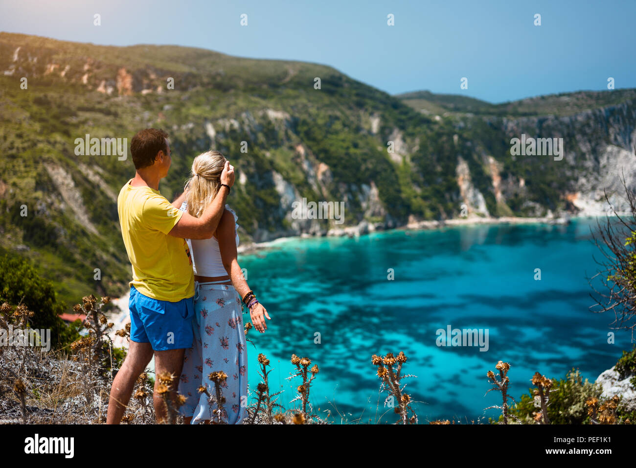 Birthday Gift Young Man Closing Hes Girlfriend Eyes In Front Of Gorgeous Seascape Panorama Blue Lagoon Couple Love Turquoise Petani Beach On Kefalonia