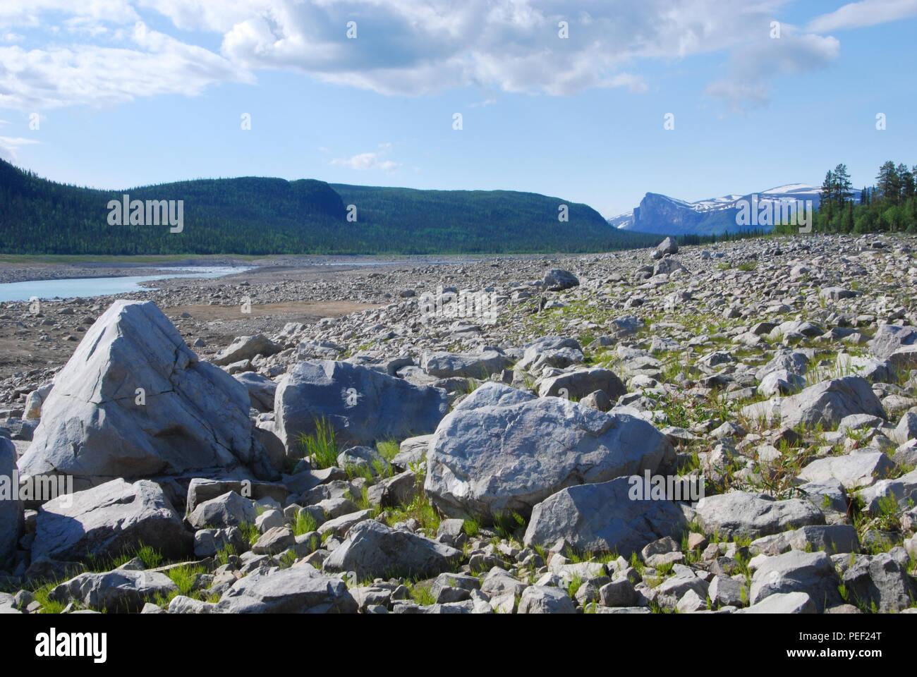 Rocky shore of (dammed) lake Tjaktjajaure. Jokkmokk, Norbotten, Sweden. 28.6.2009 - Stock Image