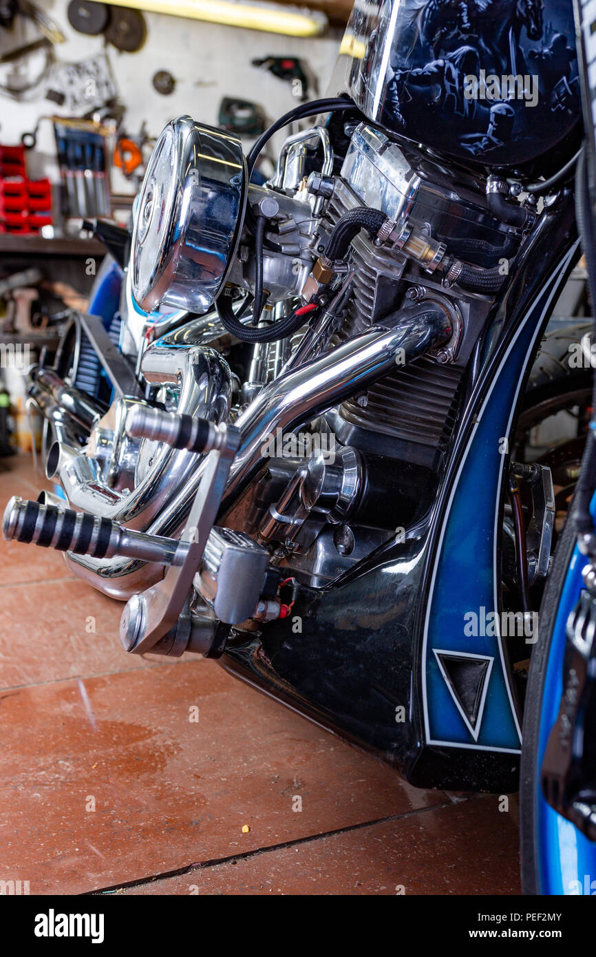 Detail on a modern motorcycle in the workshope. Motorcycle Exhaust. selective focus. Closed up and selected focused of big motorcycle engine and other - Stock Image