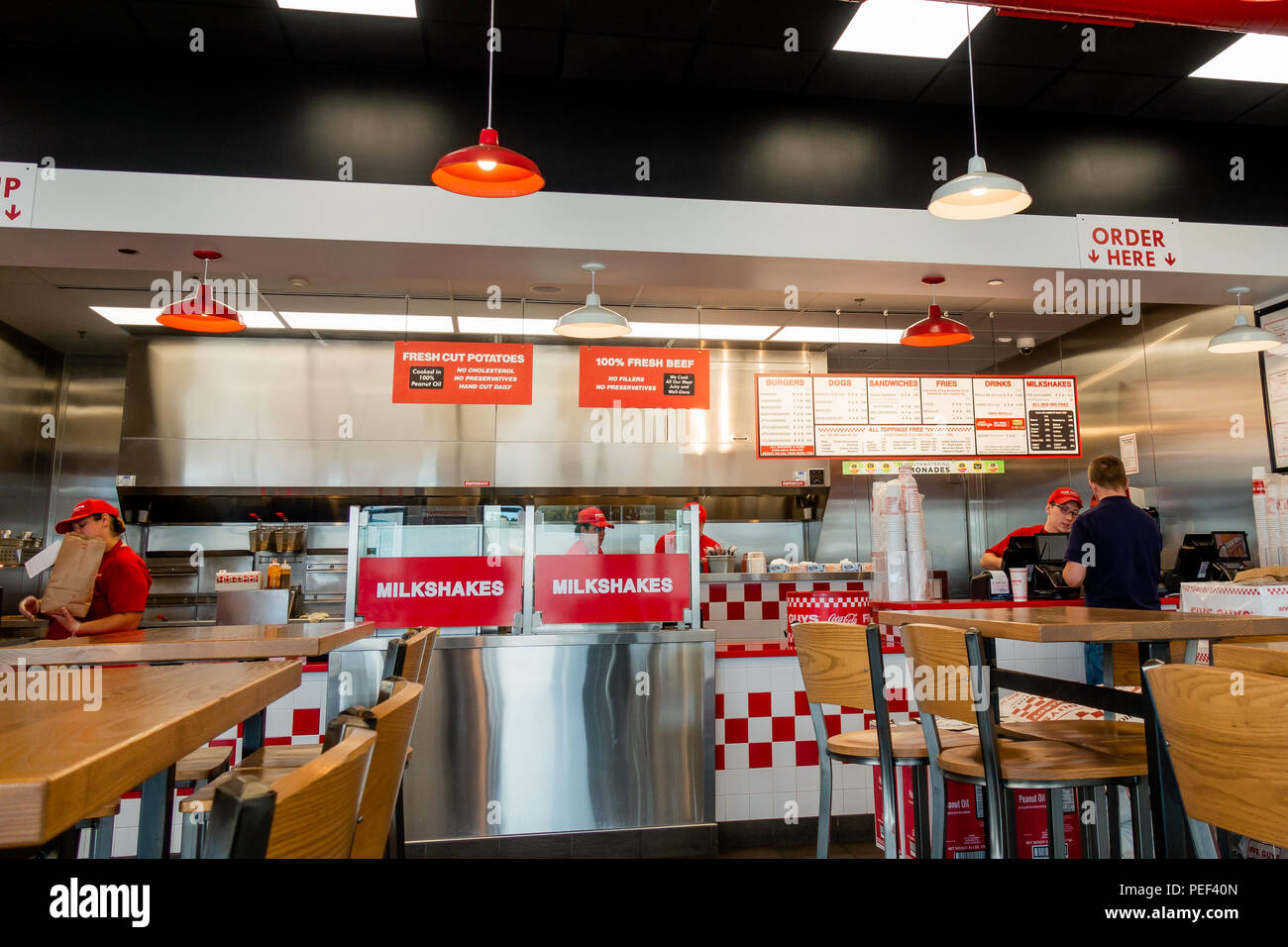 The interior of a Five Guys burger restaurant in Utica, NY USA - Stock Image
