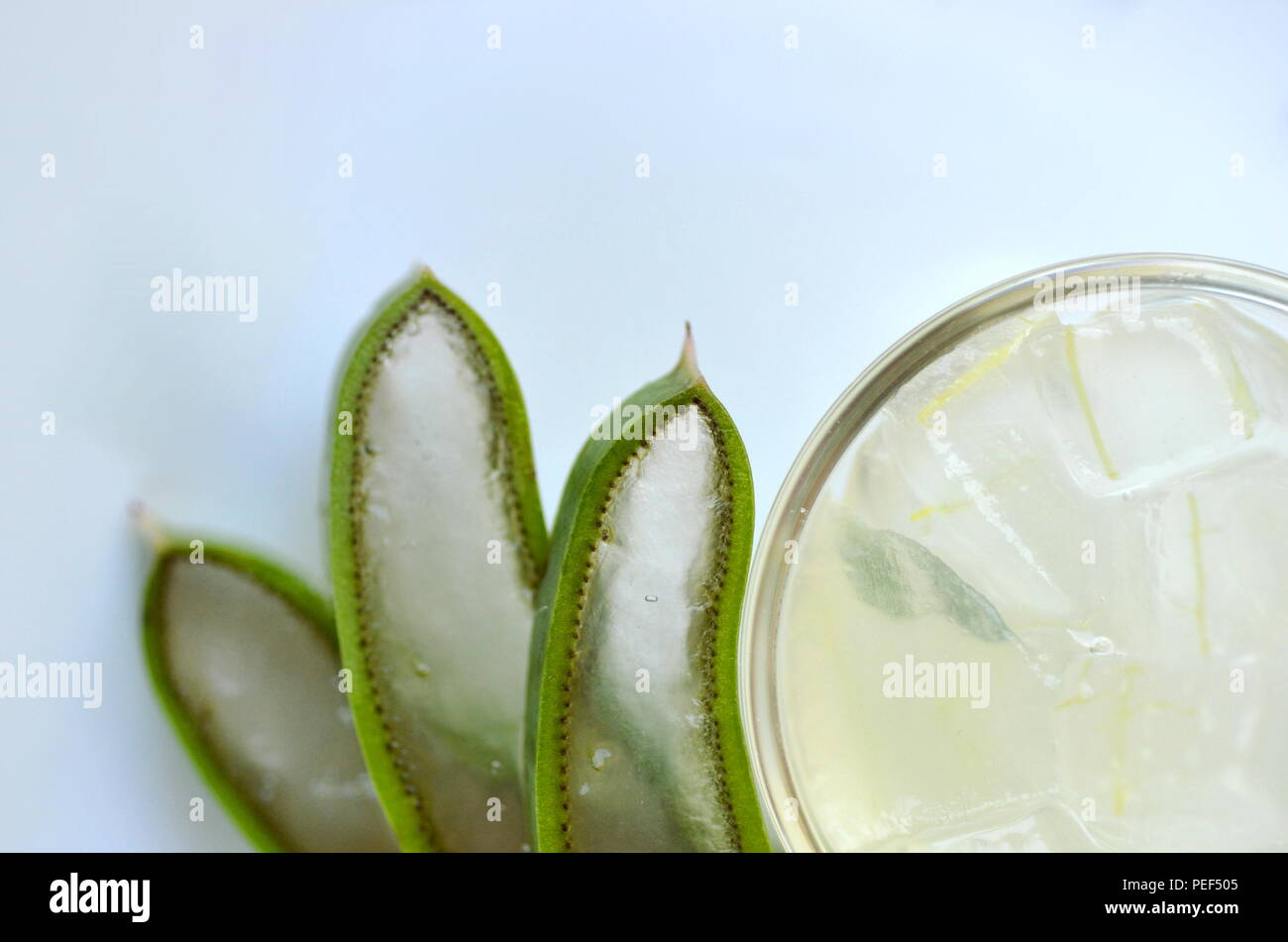 fresh cut aloe vera plant leaves with clear diced gel in a glass
