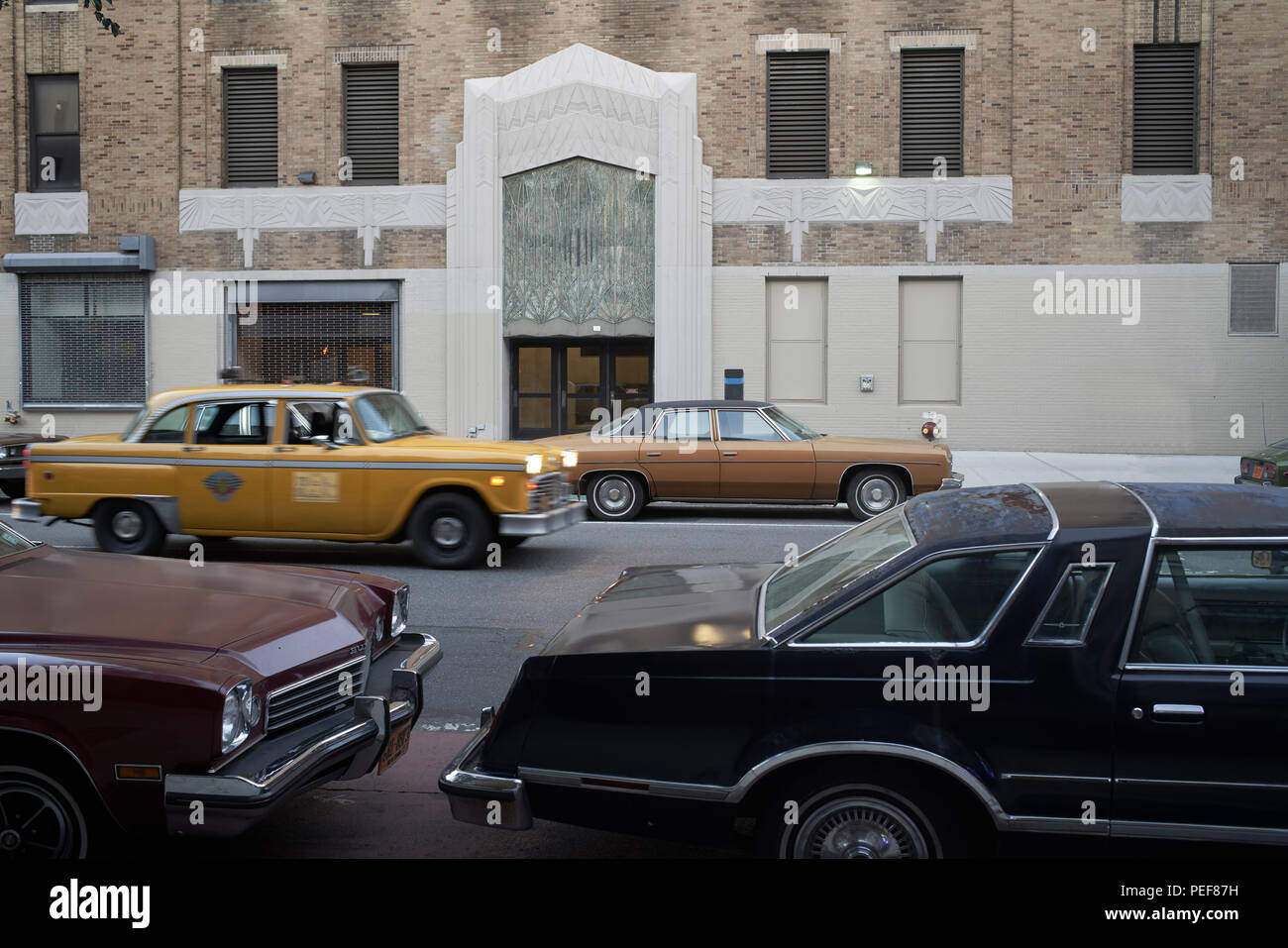 Vintage New York City Checker taxicab driving along vintage seventies cars - Stock Image