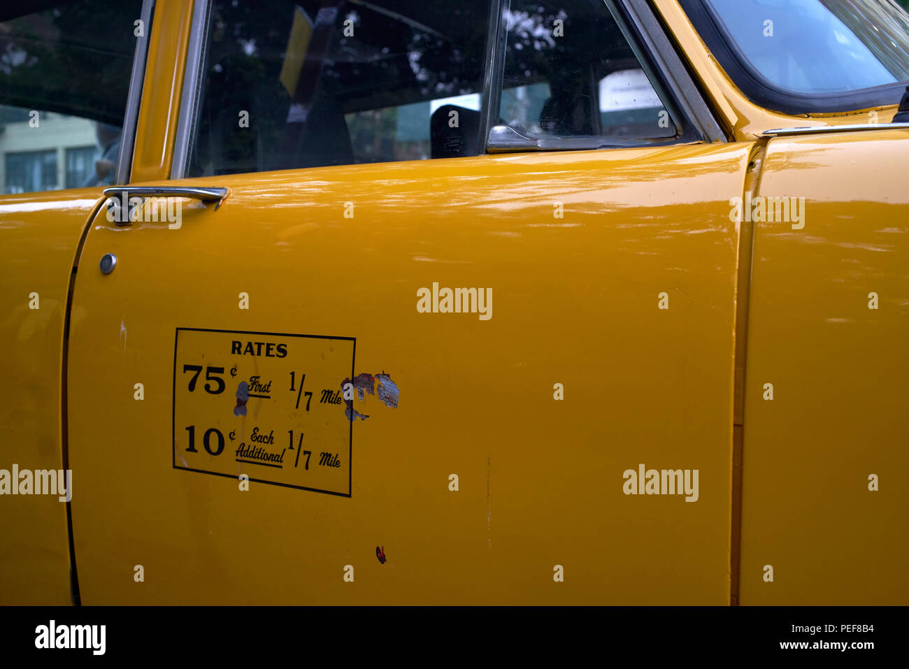 Detail of door with rates display of New York City vintage Checker taxicab - Stock Image