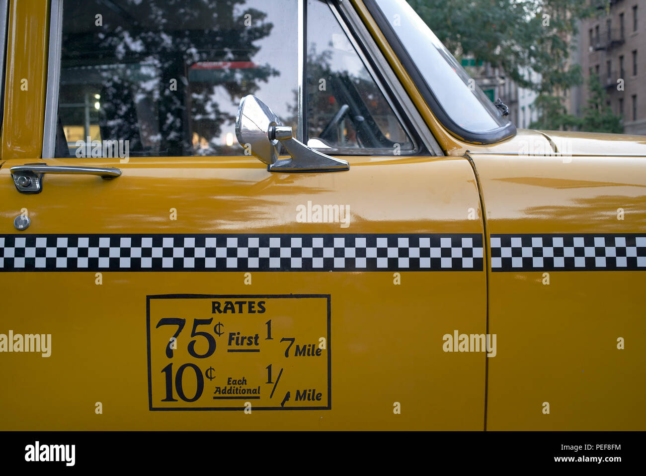 Detail of door with rates display of New York City vintage Checker taxicab Stock Photo