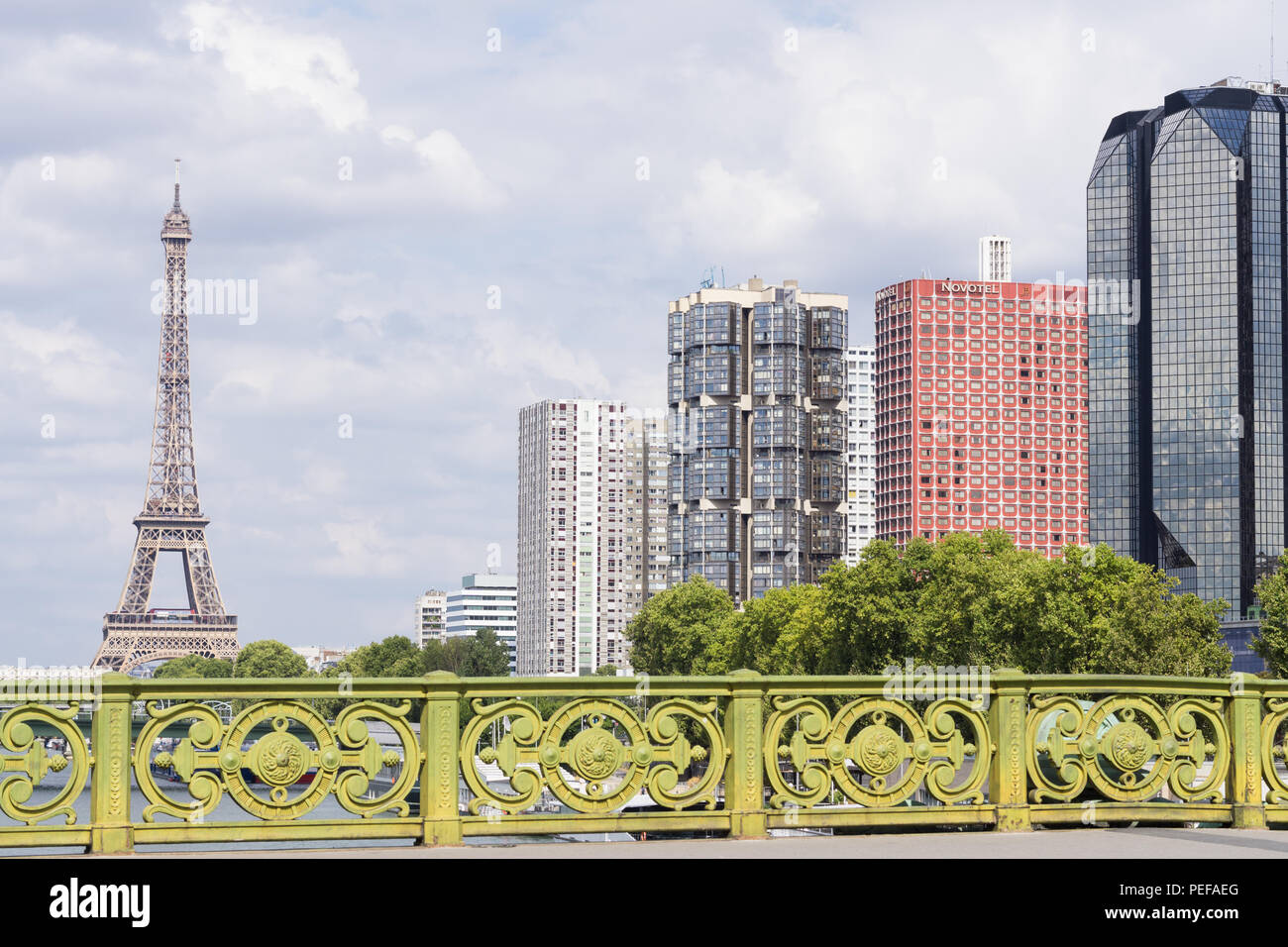 Eiffel Tower and residential skyscrapers on Quai de Grenelle seen from the Pont Mirabeau. France. - Stock Image