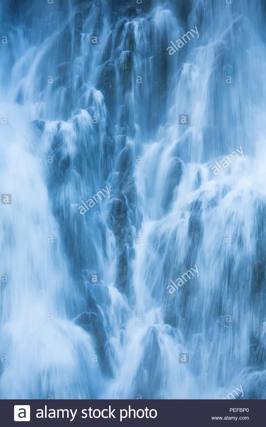A waterfall cascades into Red Bluff Bay, Baranof Island. - Stock Image
