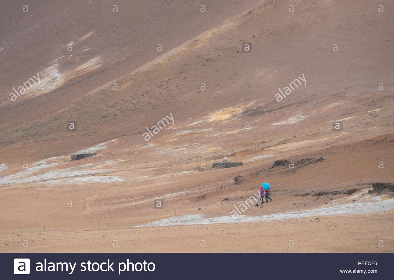 Tourists at the Hverarond mud pots. Stock Photo