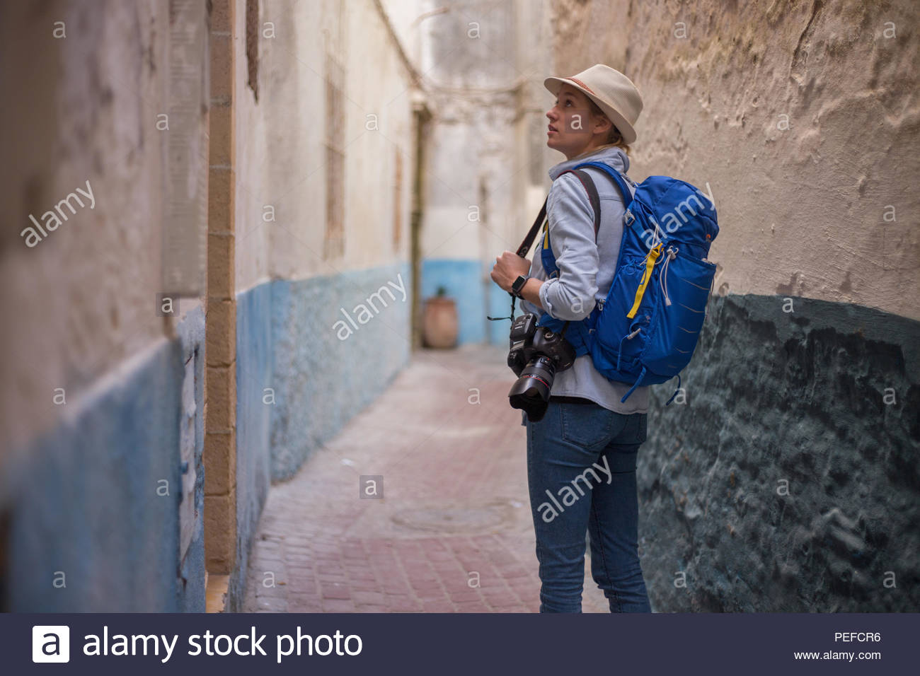 Young female tourist explores the houses in Essaouira, Morocco. Stock Photo