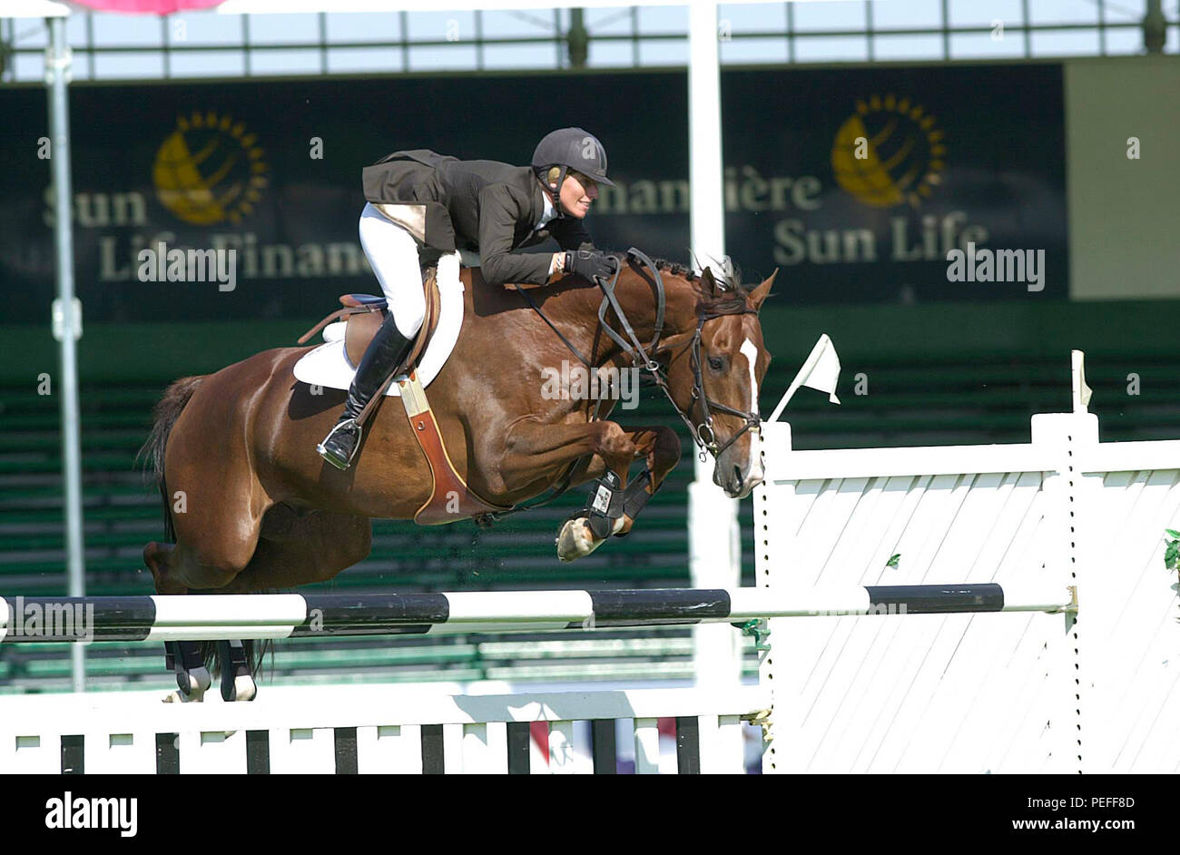 The National, Spruce Meadows, June 2001, Schuyler Riley (USA) riding Rhumbline, Akita Drilling Cup Stock Photo