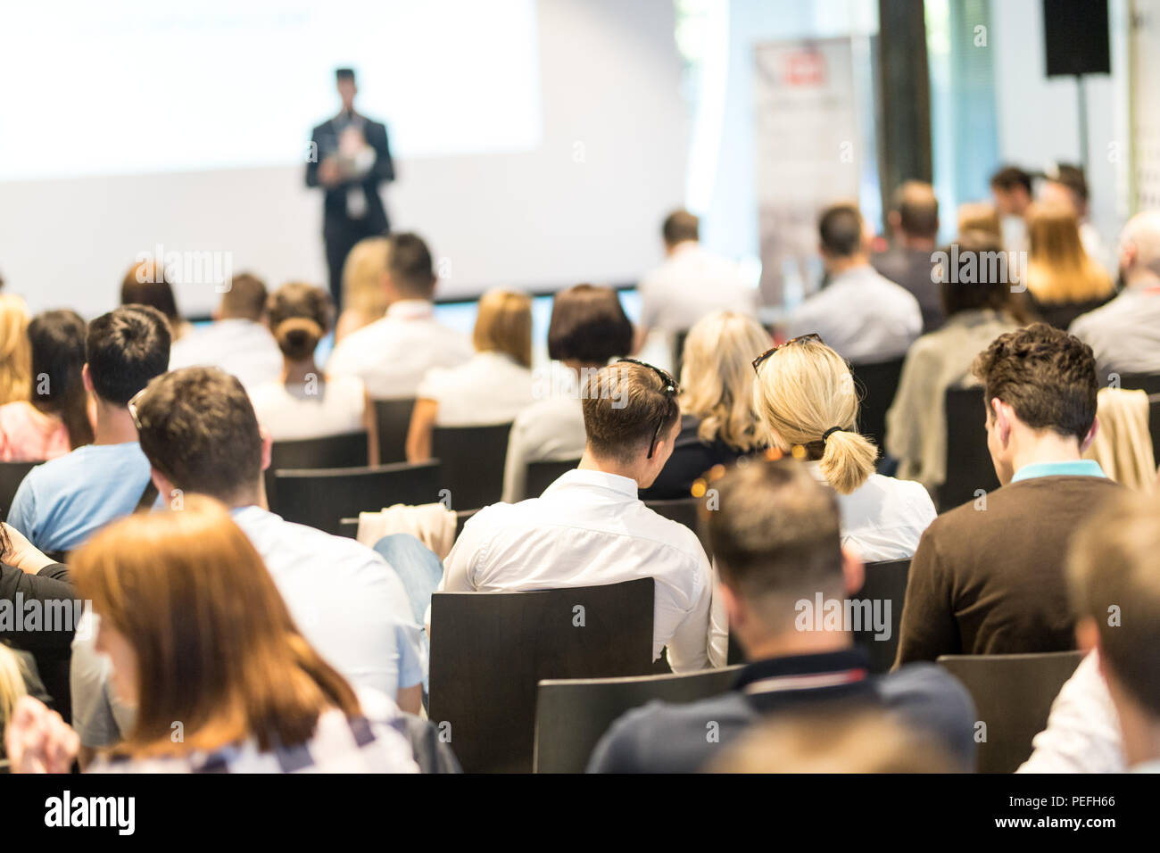 Business speaker giving a talk at business conference event. - Stock Image
