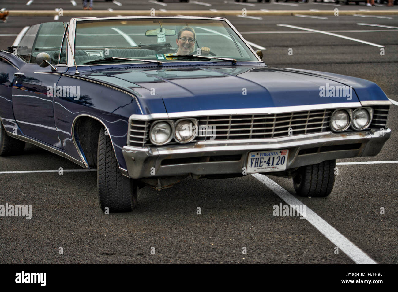 UNITED STATES: August 12, 2018: Brenda McGrath poses for some photos in her 1967 Chevrolet Impala Super Sport Convertible at the Cars & Coffee event a - Stock Image