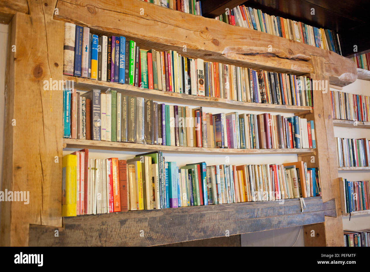 Old Books In A Wooden Bookshelf