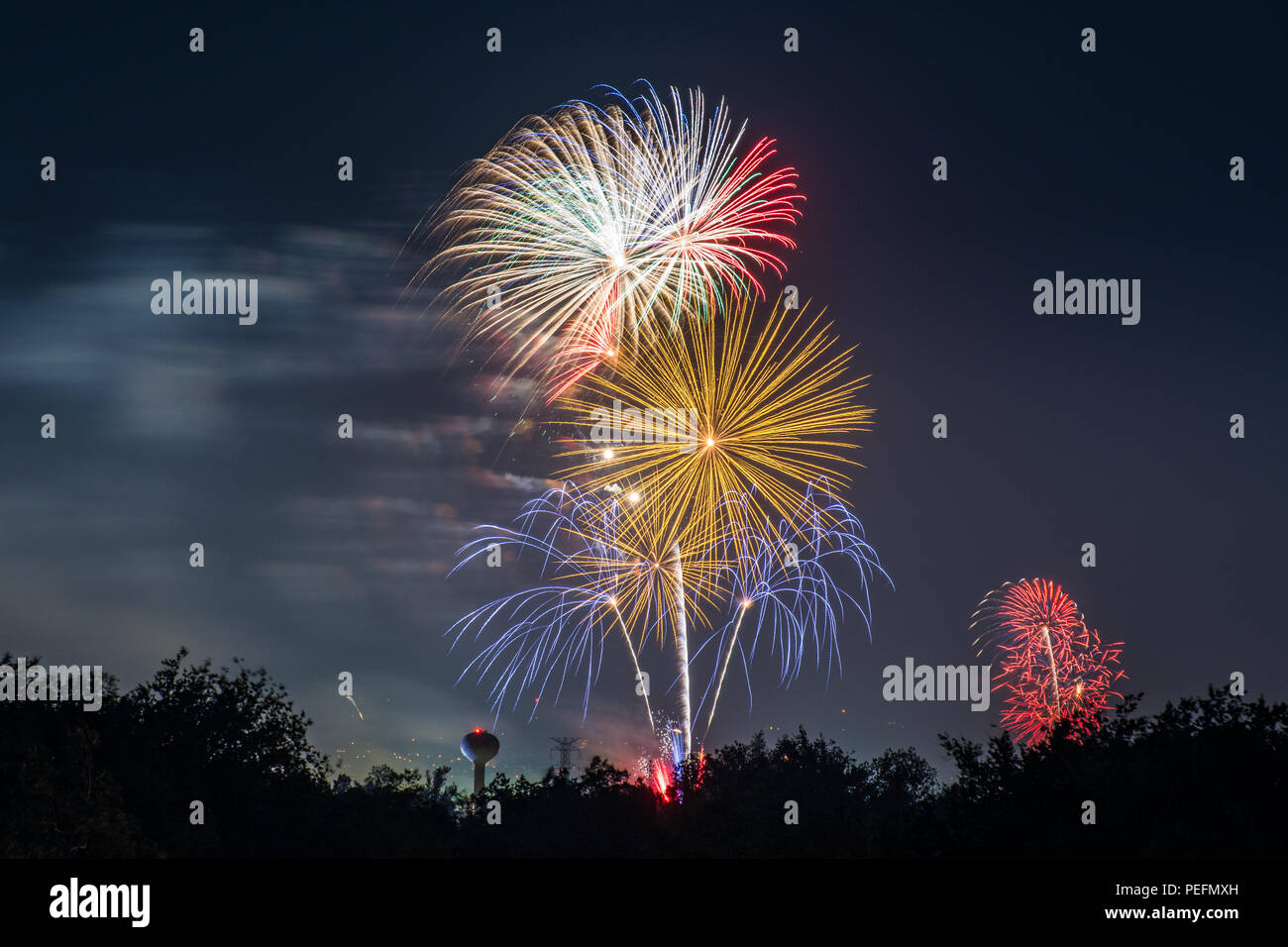 Fireworks are shot over the night sky at Cal Expo in Sacramento, California for the 4th of July. - Stock Image