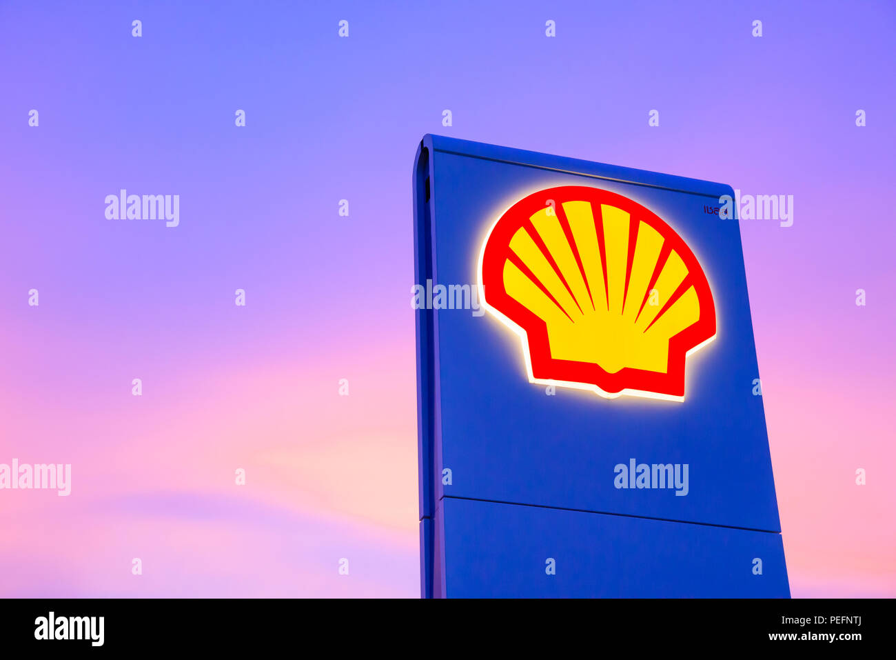 Chachoengsao, Thailand - Jan 28, 2018: Shell gas station logo with blue sky background during sunset. Royal Dutch Shell sold its Australian Shell reta - Stock Image