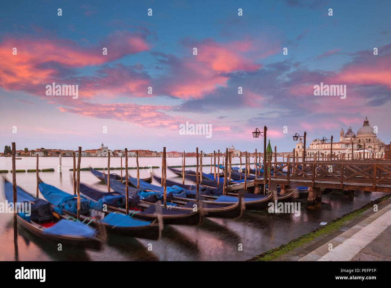 Gondolas parkked at sunset in Venice, Italy Stock Photo