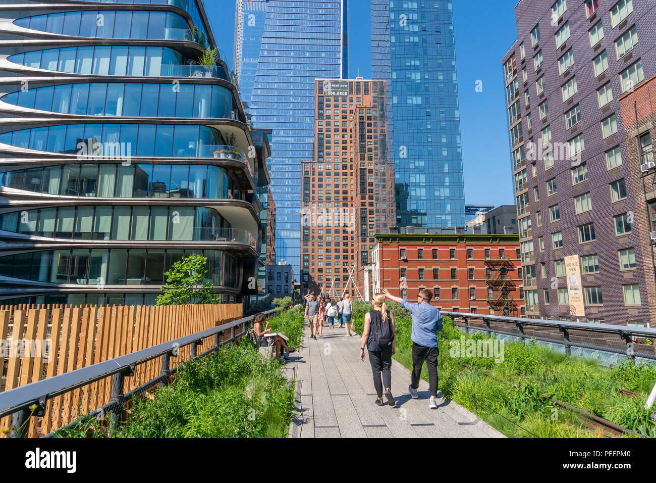 People walking along The High Line in New York Stock Photo