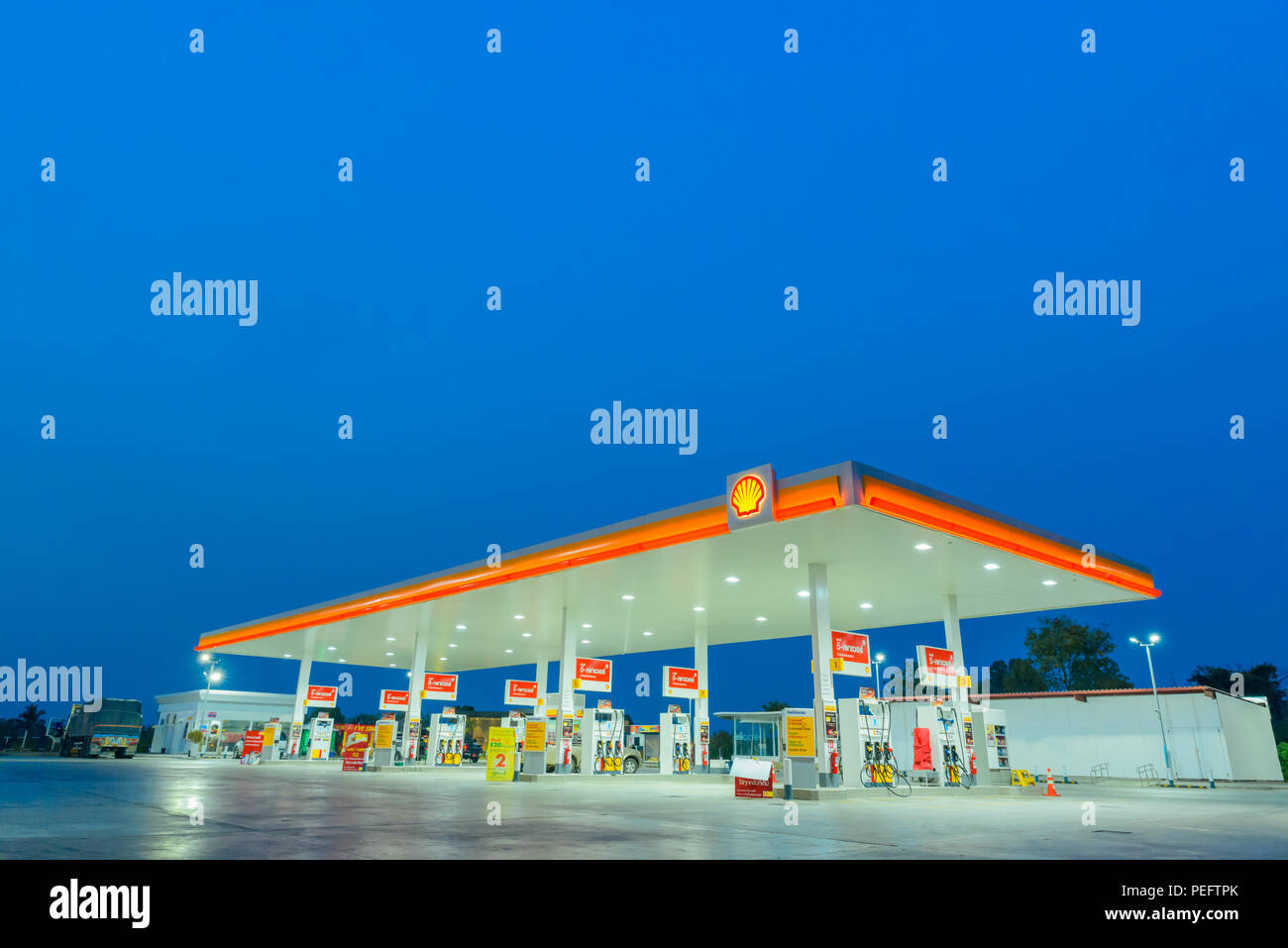 Chachoengsao, Thailand - Jan 28, 2018: Shell gas station blue sky background during sunset. Royal Dutch Shell sold its Australian Shell retail operati - Stock Image