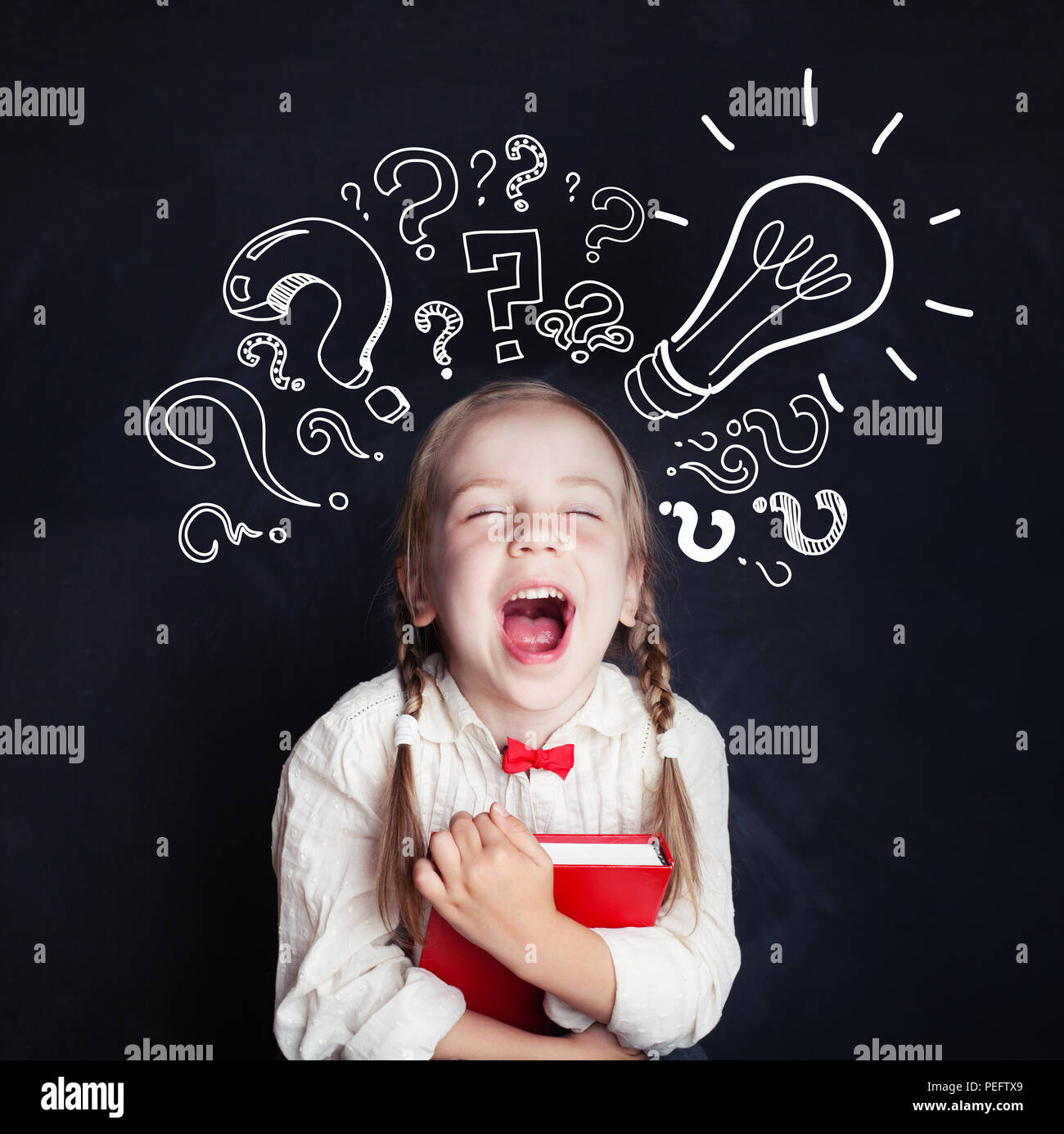 Little genius portrait. Kids education and ideas concept. Little girl with lightbulb and question marks - Stock Image
