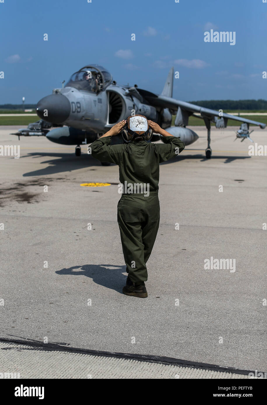 A Marine with Marine Attack Squadron (VMA) 311 directs an AV-8B Harrier II during Exercise Northern Lightning at Volk Field Counterland Training Center, Camp Douglas, Wis. Aug. 13. Exercise Northern Lightning 2018 allows the Air Force, Marine Corps and Navy to strengthen interoperability between services and gives the different branches a greater understanding of aviation capabilities within a joint fighting force. (U.S. Marine Corps photo by Sgt. David Bickel) Stock Photo