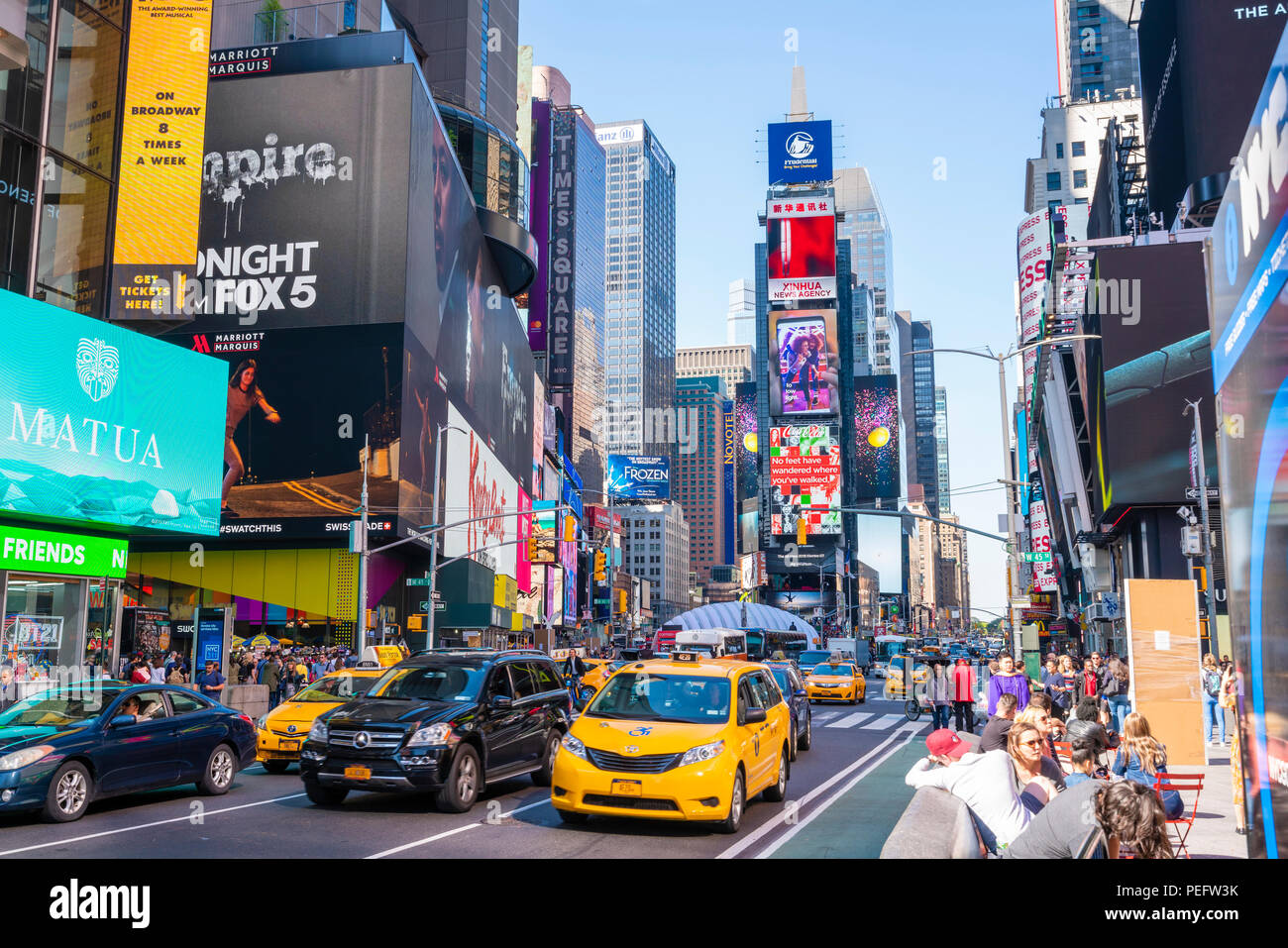People and traffic at Times Square in New York City - Stock Image