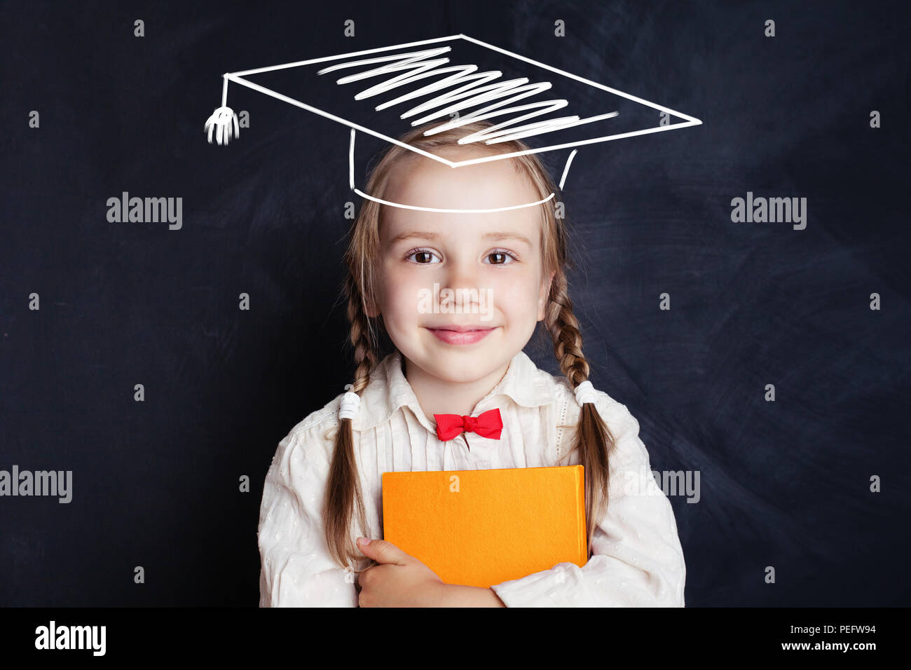 School Child With Education Book And Graduation Hat On Blackboard Banner Background Stock Photo Alamy