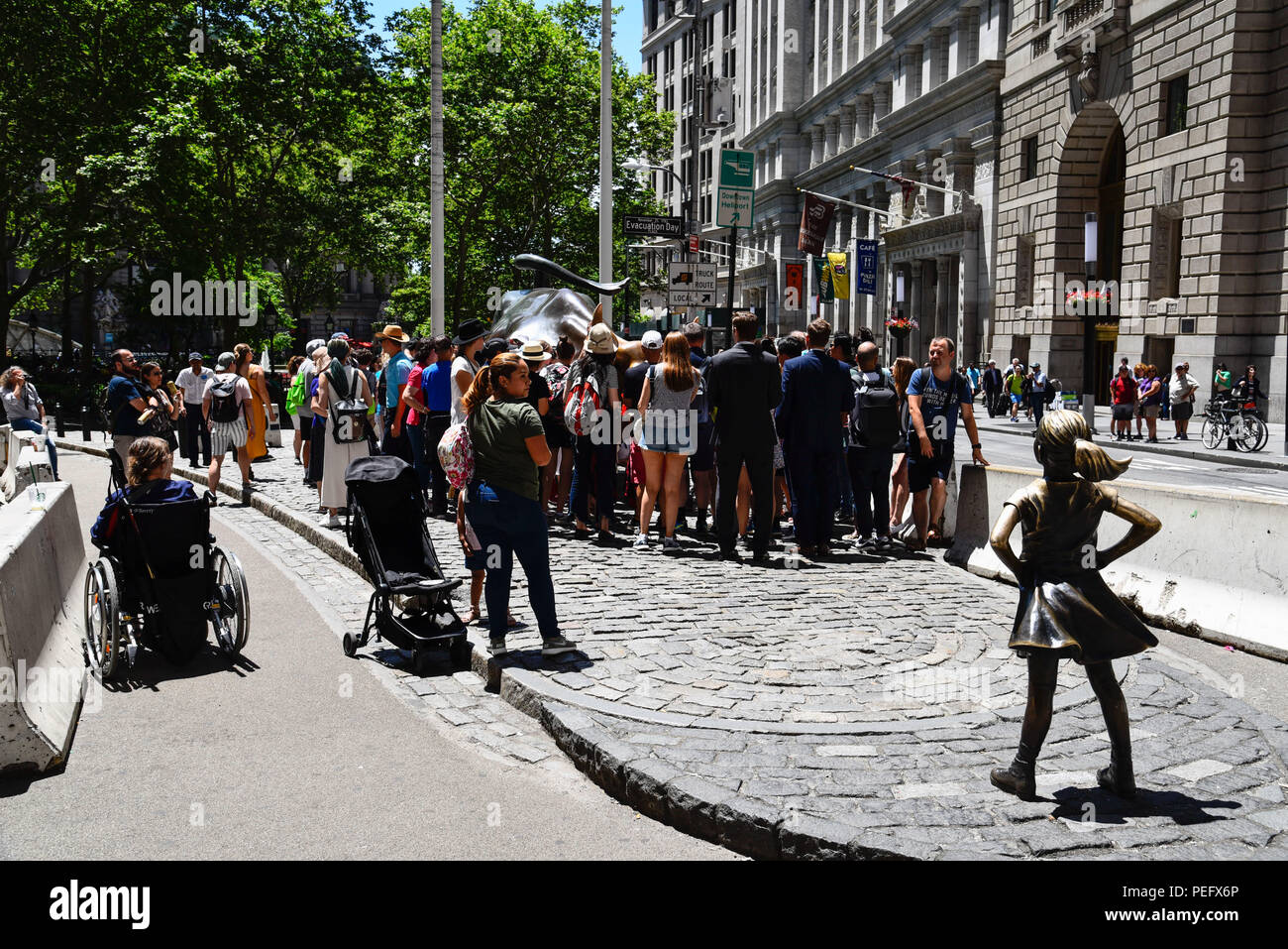 New York City, USA - June 20, 2018: Crowd of people in Charging Bull and Fearless Girl Sculptures in Financial District - Stock Image