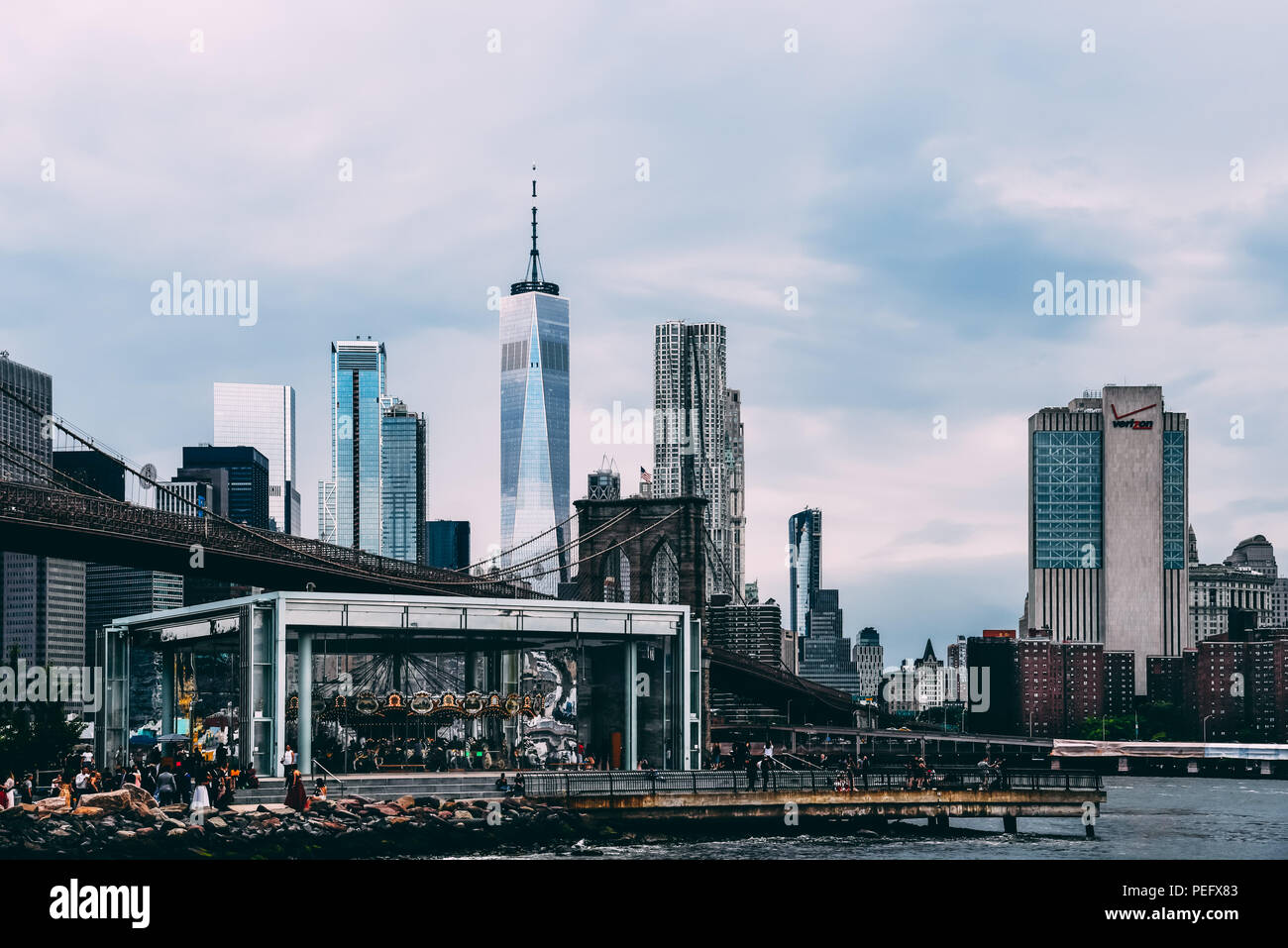 New York City, USA - June 20, 2018: Scenic view of skyline from promenade by East River in DUMBO, Brooklyn - Stock Image