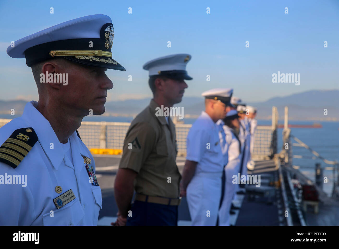150817-M-GO800-045 DA NANG, Vietnam (August 17, 2015) – Service members with Pacific Partnership 2015 man the rails aboard the Military Sealift Command joint high speed vessel USNS Millinocket (JHSV 3)  Aug. 17 as the ship arrives in Vietnam. Task Force Forager, embarked aboard Millinocket is serving as the secondary platform for Pacific Partnership, led by an expeditionary command element from the Navy's 30th Naval Construction Regiment (30 NCR) from Port Hueneme, California. Now in its 10th iteration, Pacific Partnership is the largest annual multilateral humanitarian assistance and disaster - Stock Image