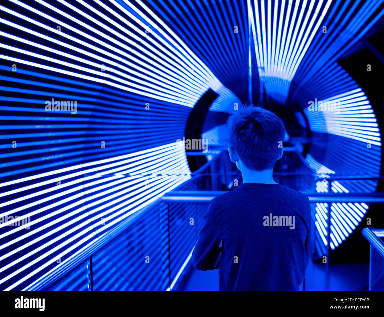 CANBERRA,ACT,AUSTRALIA: JULY 11, 2018. Questacon – The National Science and Technology Centre Canberra. A child enters the UV tunnel.Jayne Russell/ Al Stock Photo