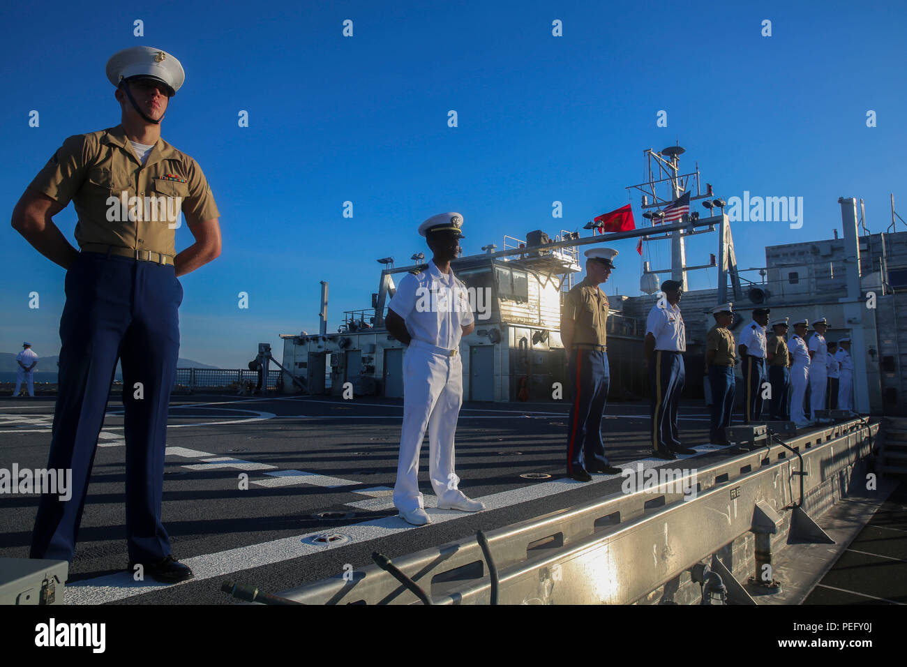 150817-M-GO800-098 DA NANG, Vietnam (August 17, 2015) – Service members with Pacific Partnership 2015 man the rails aboard the Military Sealift Command joint high speed vessel USNS Millinocket (JHSV 3)  Aug. 17 as the ship arrives in Vietnam. Task Force Forager, embarked aboard Millinocket is serving as the secondary platform for Pacific Partnership, led by an expeditionary command element from the Navy's 30th Naval Construction Regiment (30 NCR) from Port Hueneme, California. Now in its 10th iteration, Pacific Partnership is the largest annual multilateral humanitarian assistance and disaster - Stock Image