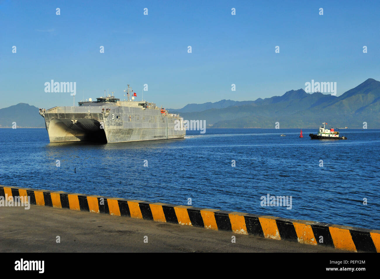 150817-N-YF678-024 DA NANG, Vietnam (Aug. 17, 2015) – The Military Sealift Command joint high speed vessel USNS Millinocket (JHSV 3) arrives in Vietnam, Aug. 17. Vietnam is the fifth stop for Millinocket and embarked Task Force Forager. Millinocket and embarked Task Force Forager are serving as the secondary platform for Pacific Partnership, led by an expeditionary command element from the Navy's 30th Naval Construction Regiment (30 NCR) from Port Hueneme, Calif. Now in its 10th iteration, Pacific Partnership is the largest annual multilateral humanitarian assistance and disaster relief prepar - Stock Image