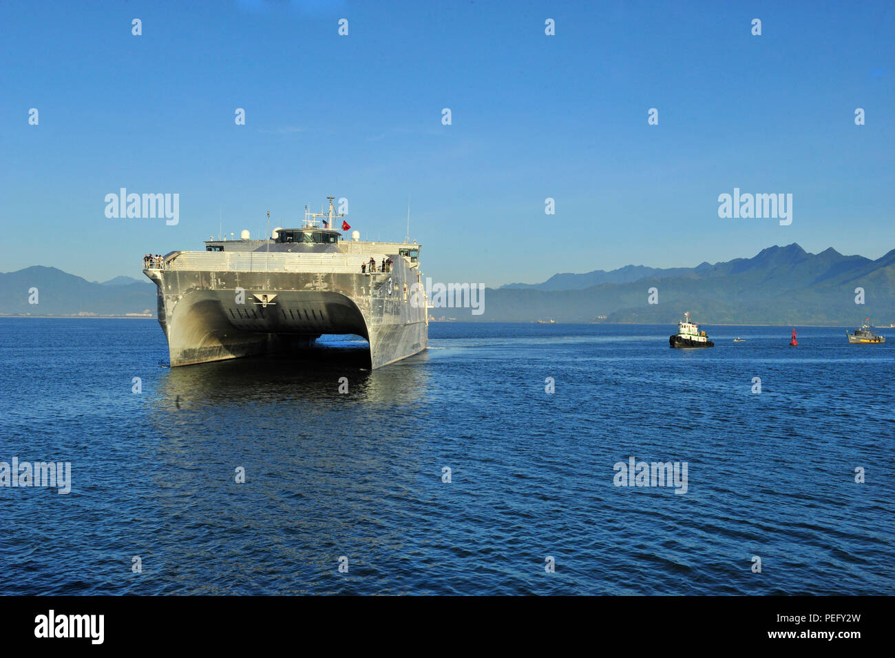 150817-N-YF678-033 DA NANG, Vietnam (Aug. 17, 2015) – The Military Sealift Command joint high speed vessel USNS Millinocket (JHSV 3) arrives in Vietnam, Aug. 17. Vietnam is the fifth stop for Millinocket and embarked Task Force Forager. Millinocket and embarked Task Force Forager are serving as the secondary platform for Pacific Partnership, led by an expeditionary command element from the Navy's 30th Naval Construction Regiment (30 NCR) from Port Hueneme, Calif. Now in its 10th iteration, Pacific Partnership is the largest annual multilateral humanitarian assistance and disaster relief prepar - Stock Image