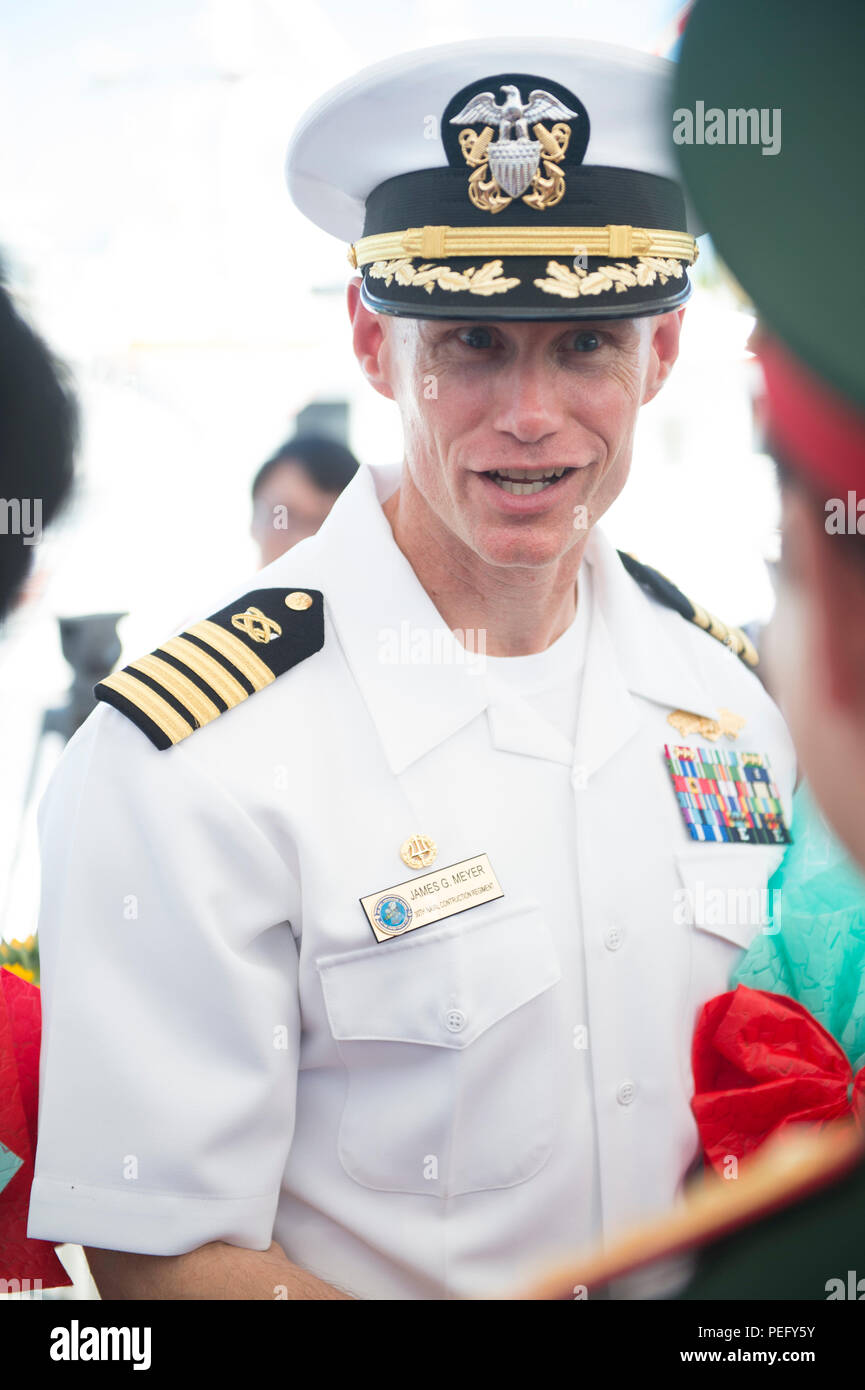 150817-N-MK341-112 DA NANG, Vietnam (Aug. 17, 2015) – Commodore, Task Force Forager Capt. James Meyer talks with a local military leader, Aug. 17.  Vietnam is the fifth stop for the Military Sealift Command joint high speed vessel USNS Millinocket (JHSV 3) and embarked Task Force Forager. Millinocket and embarked Task Force Forager are serving as the secondary platform for Pacific Partnership, led by an expeditionary command element from the Navy's 30th Naval Construction Regiment (30 NCR) from Port Hueneme, Calif. Now in its 10th iteration, Pacific Partnership is the largest annual multilater - Stock Image