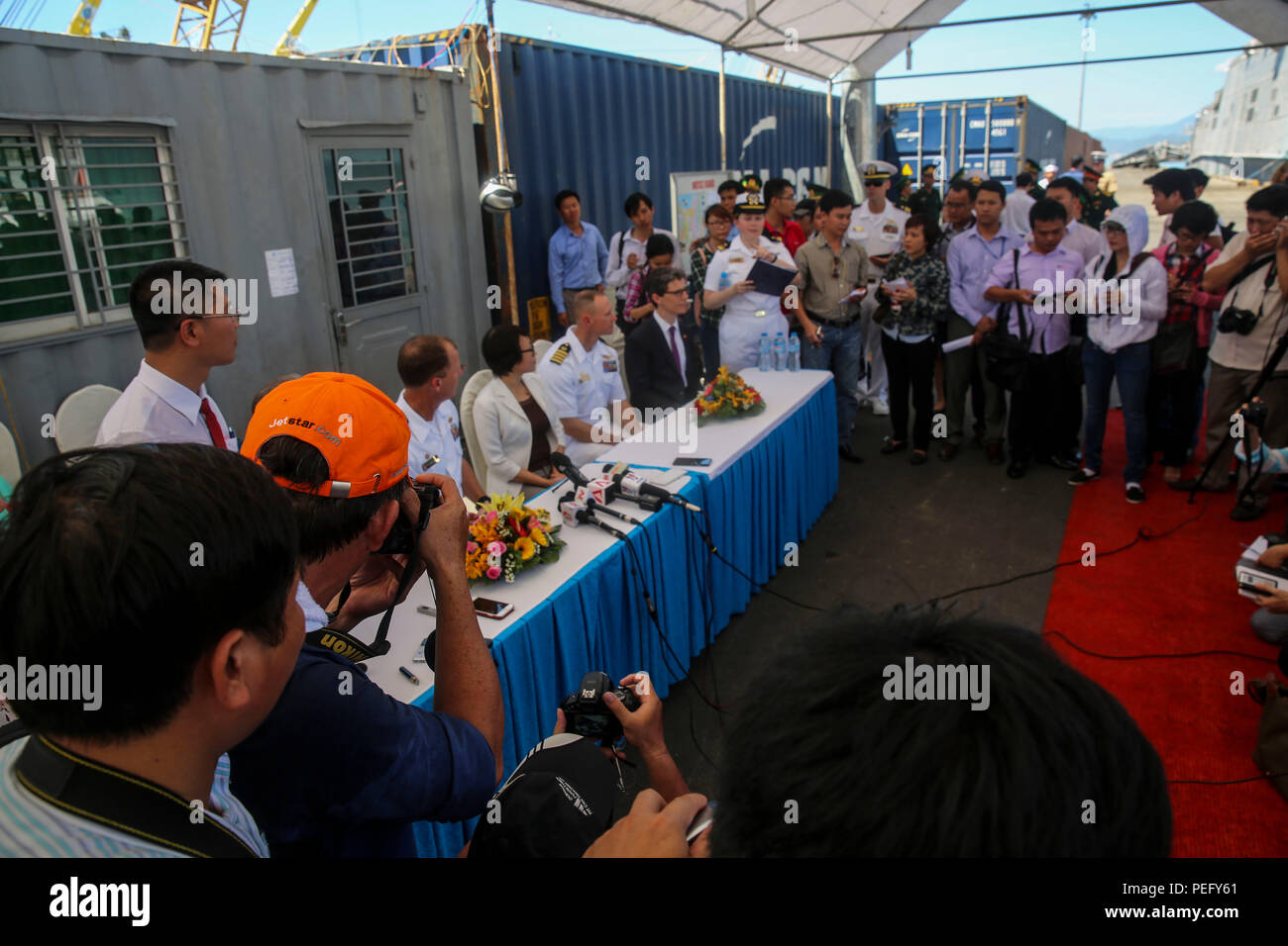 150817-M-GO800-162 DA NANG, Vietnam (Aug. 17, 2015) – Pacific Partnership 2015 leadership answers questions from local Vietnamese news outlets August 17. Task Force Forager, embarked aboard the Military Sealift Command joint high speed vessel USNS Millinocket (JHSV 3) is serving as the secondary platform for Pacific Partnership, led by an expeditionary command element from the Navy's 30th Naval Construction Regiment (30 NCR) from Port Hueneme, Calif. Now in its 10th iteration, Pacific Partnership is the largest annual multilateral humanitarian assistance and disaster relief preparedness missio - Stock Image