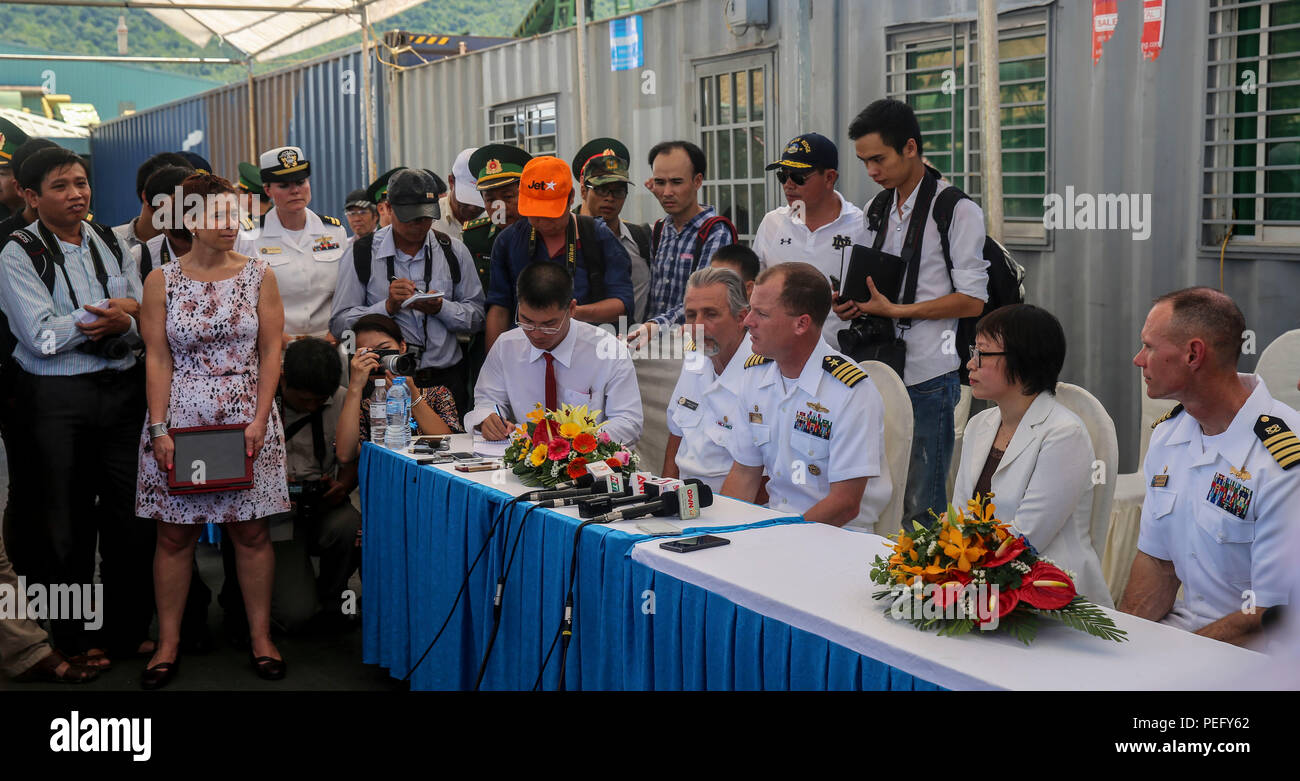 150817-M-GO800-205 DA NANG, Vietnam (Aug. 17, 2015) – Pacific Partnership 2015 leadership answers questions from local Vietnamese news outlets Aug. 17. Task Force Forager, embarked aboard the Military Sealift Command joint high speed vessel USNS Millinocket (JHSV 3) is serving as the secondary platform for Pacific Partnership, led by an expeditionary command element from the Navy's 30th Naval Construction Regiment (30 NCR) from Port Hueneme, Calif. Now in its 10th iteration, Pacific Partnership is the largest annual multilateral humanitarian assistance and disaster relief preparedness mission  - Stock Image