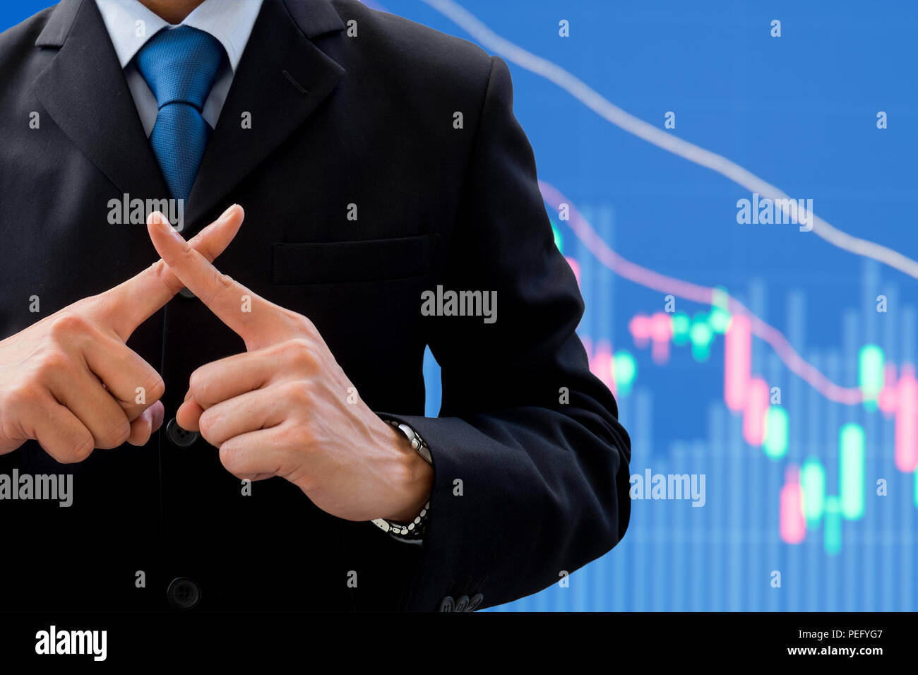 Businessman in dark gray suit using his hands as cross. Meaning wrong, fault, not correct, not allow, prohibit. Global business and stock market decre - Stock Image