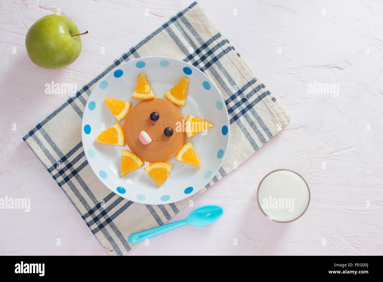 Funny pancakes with orange for kids breakfast Stock Photo