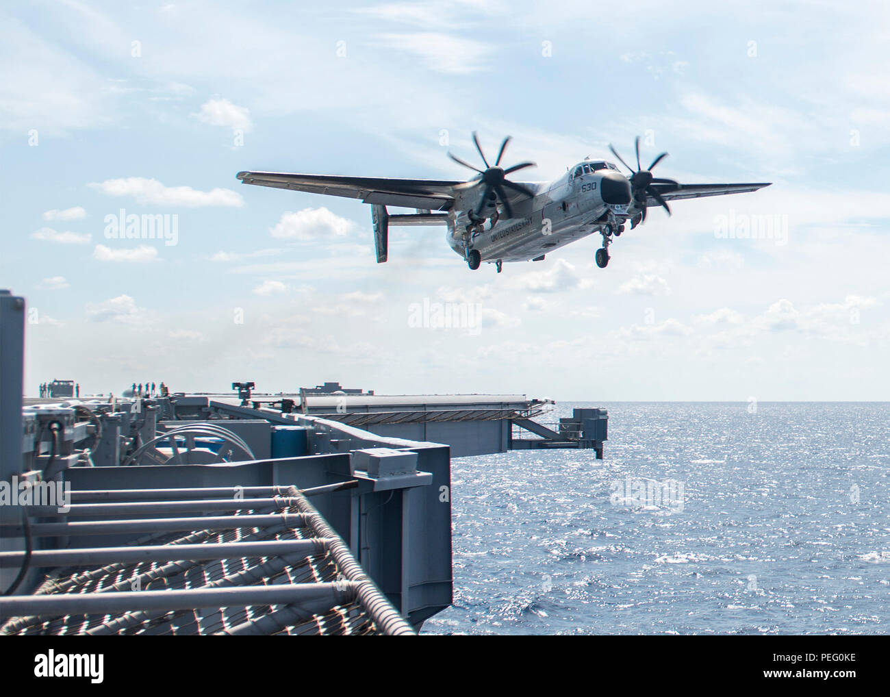 150814-N-MQ094-848 ATLANTIC OCEAN (Aug. 14, 2015) A C-2A Greyhound assigned to the Rawhides of Fleet Logistic Support Squadron (VRC) 40 flies over the flight deck of the aircraft carrier USS Harry S. Truman (CVN 75). Harry S. Truman is underway conducting carrier qualifications in preparation for its upcoming deployment. (U.S. Navy photo by Mass Communication Specialist 3rd Class E. T. Miller/Released) - Stock Image